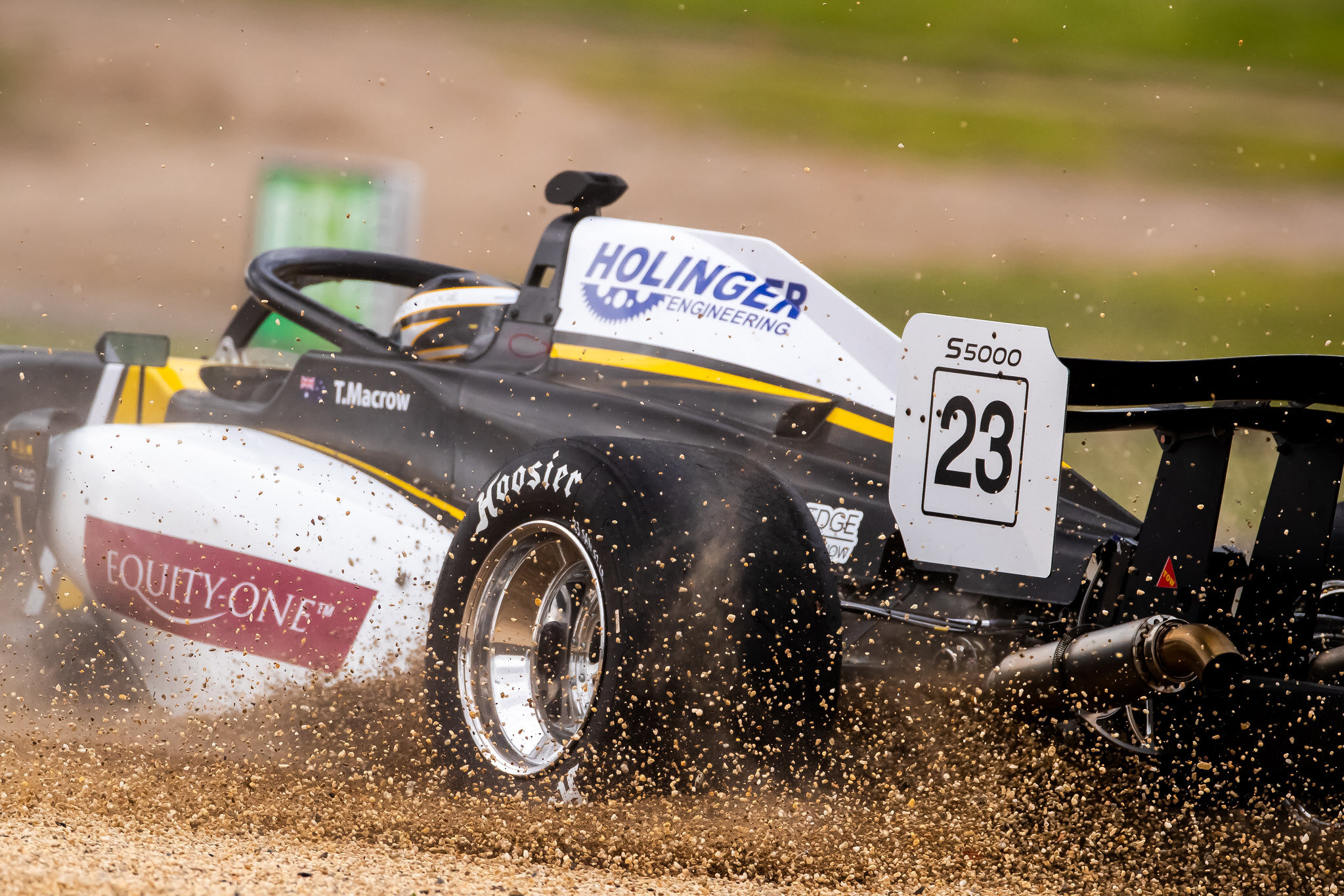 Tim Macrow spins into the gravel. Image: S5000
