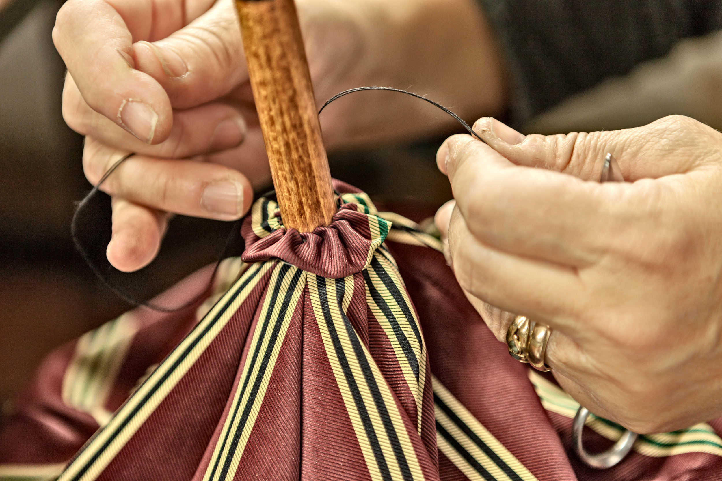 "A ""rosetta"" being hand sewn over the top notch.  Photo credit: LucaPradella"