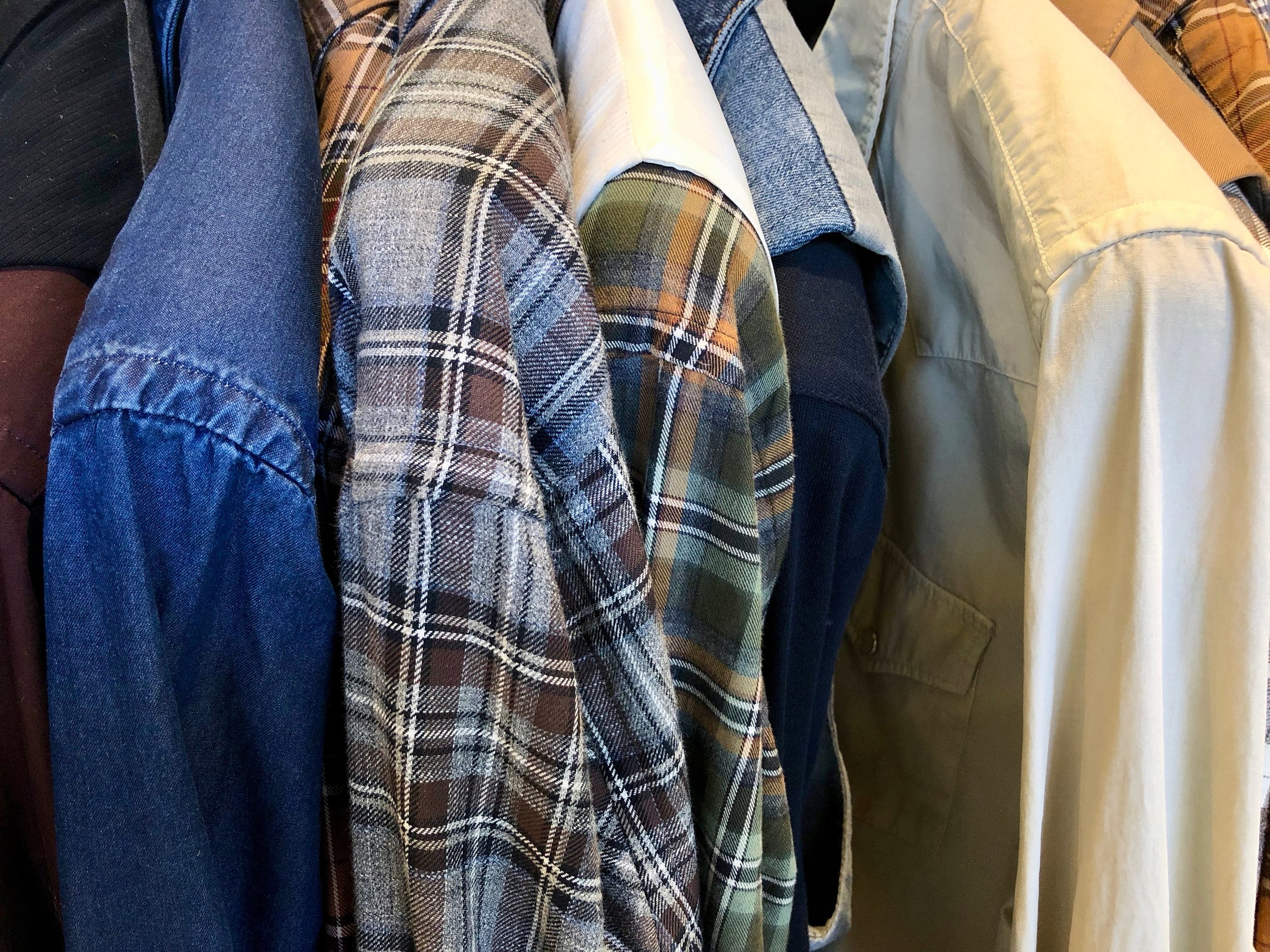 Close-up of a dizzying choice of shirts.  Photo credit: @LucaMontini