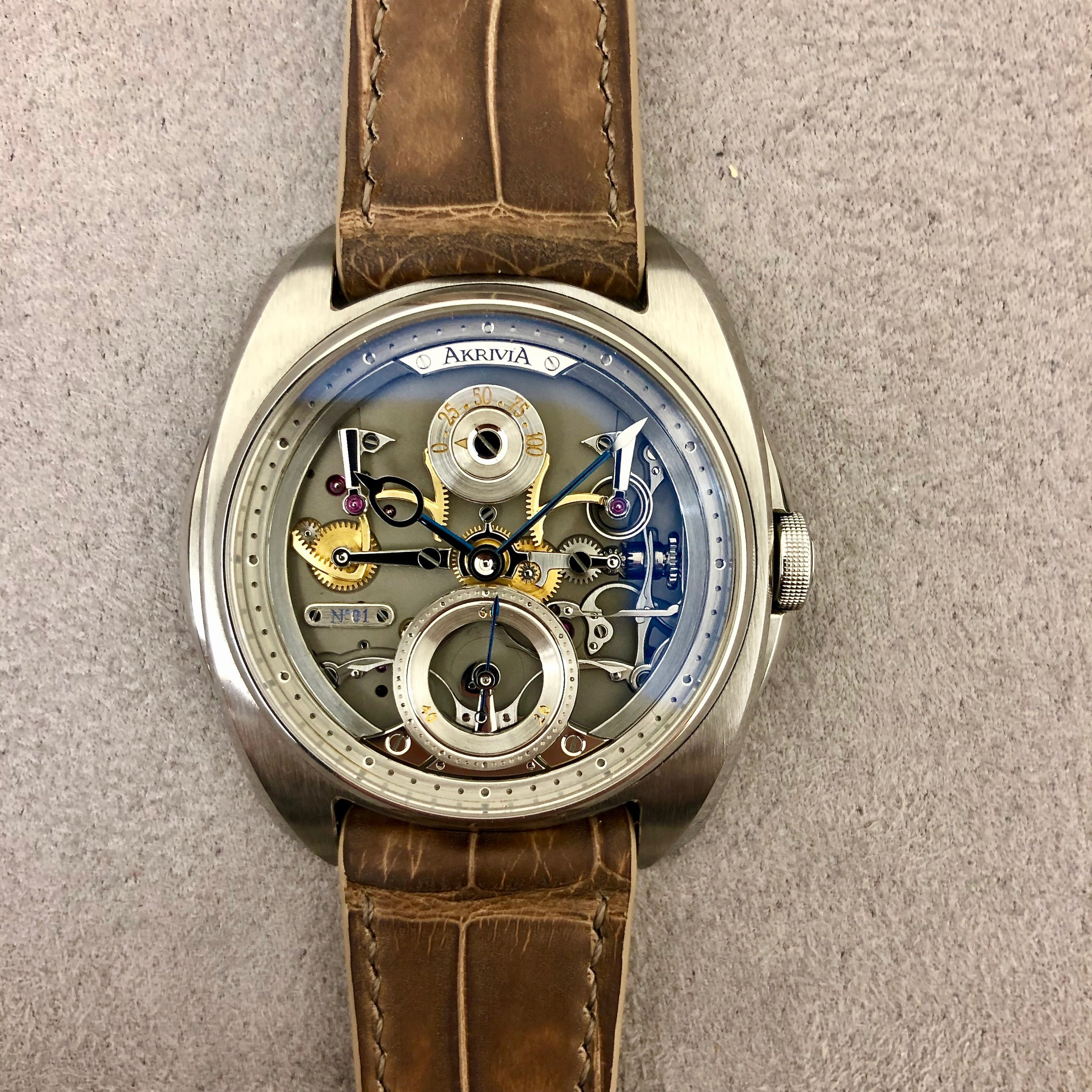 """Close-up of the AK-06, Akrivia's first venture beyond the Tourbillon: look at those movement parts """"surfacing"""" on the dial."""
