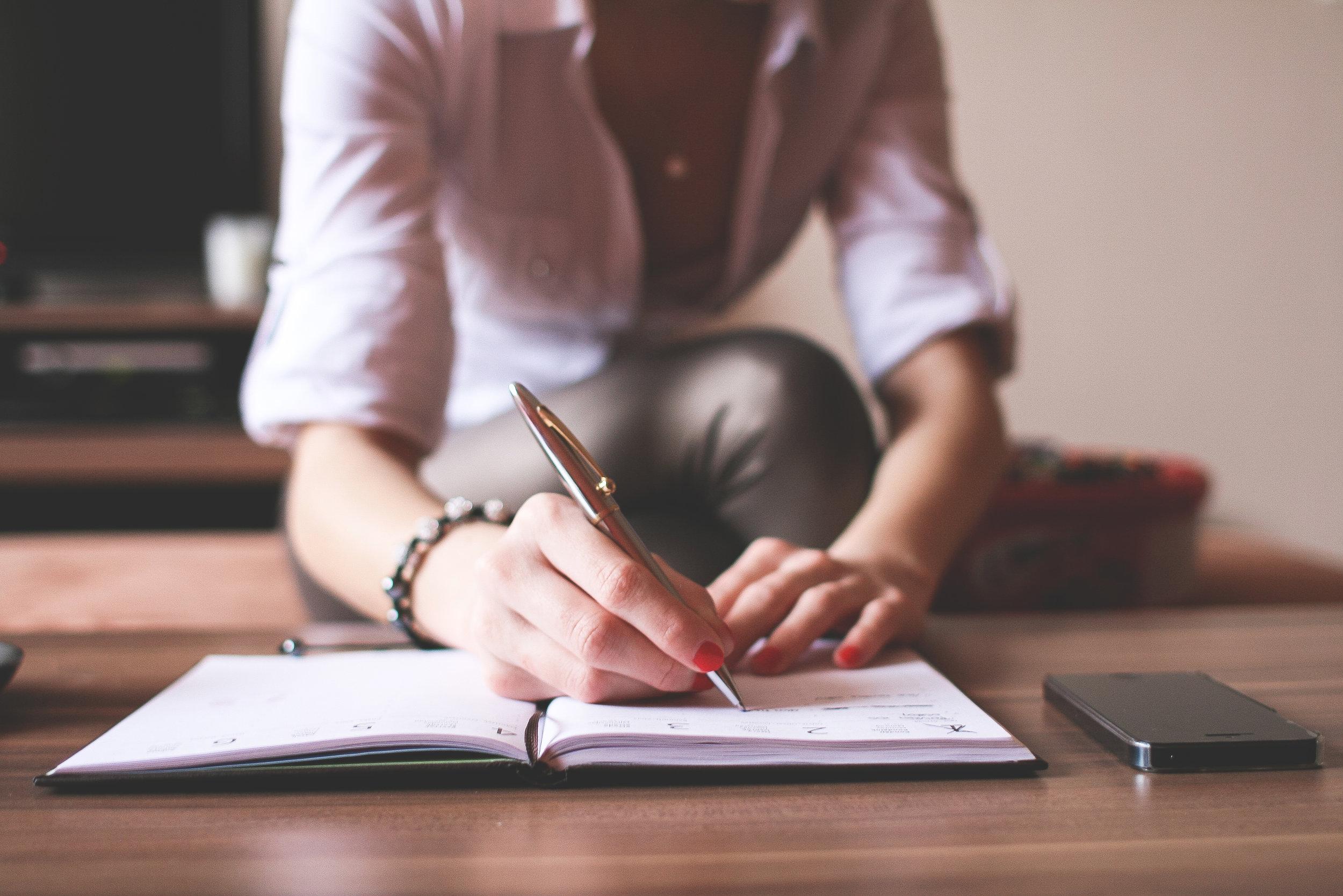 girl-writing-in-a-diary-picjumbo-com.jpg