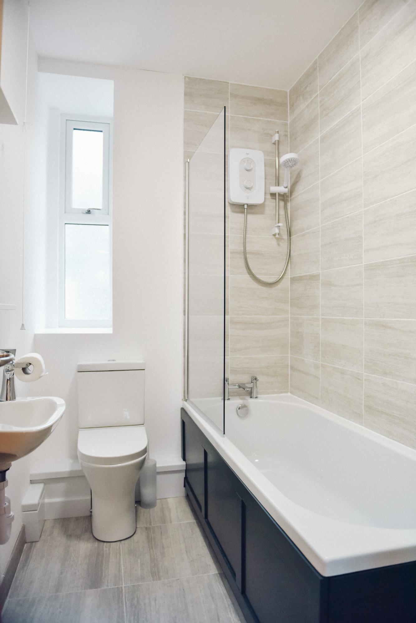 En suite shower-bathroom with toilet