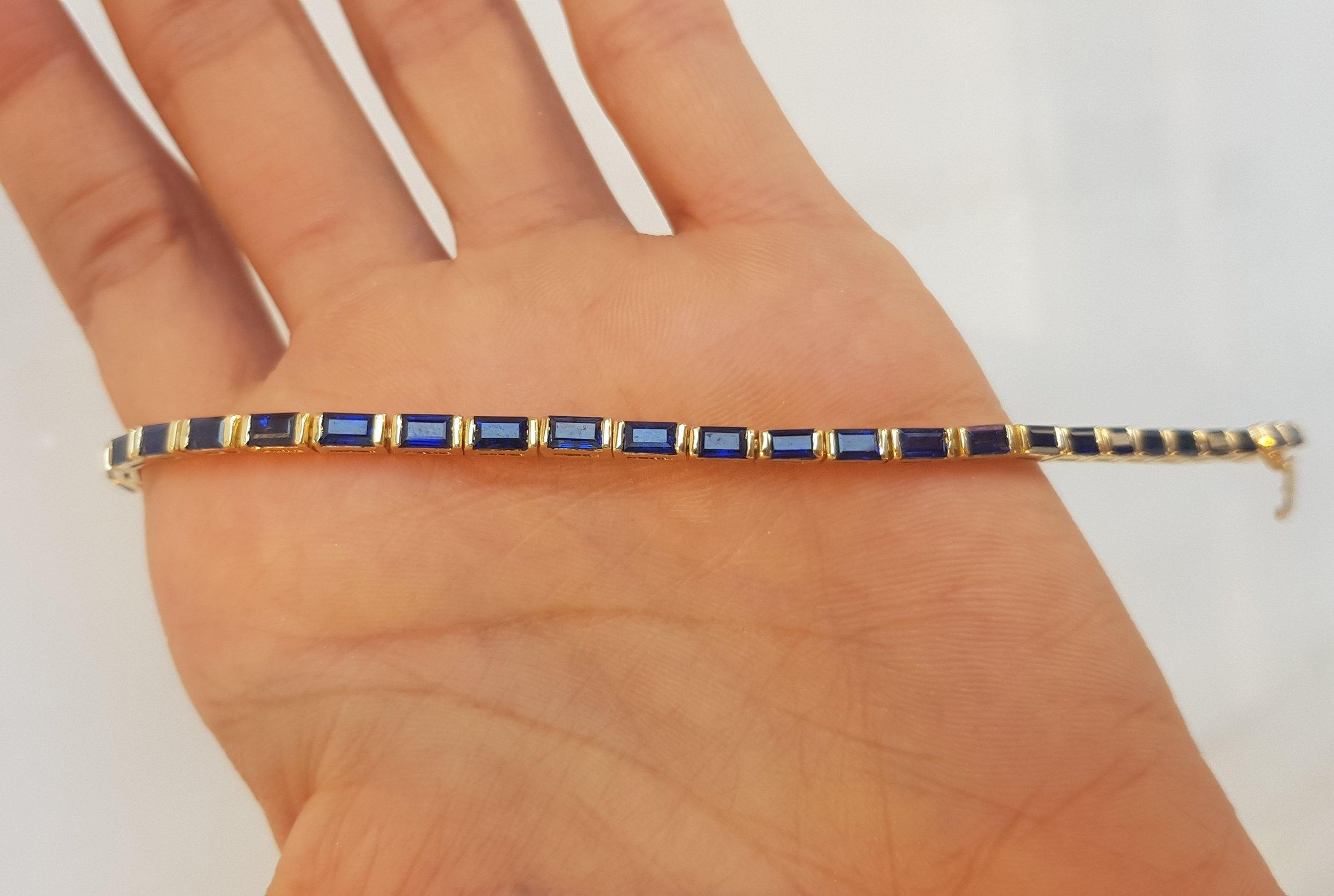 a.h. bracelet - 18k yellow gold set with baguette cut natural royal blue ceylon sapphires