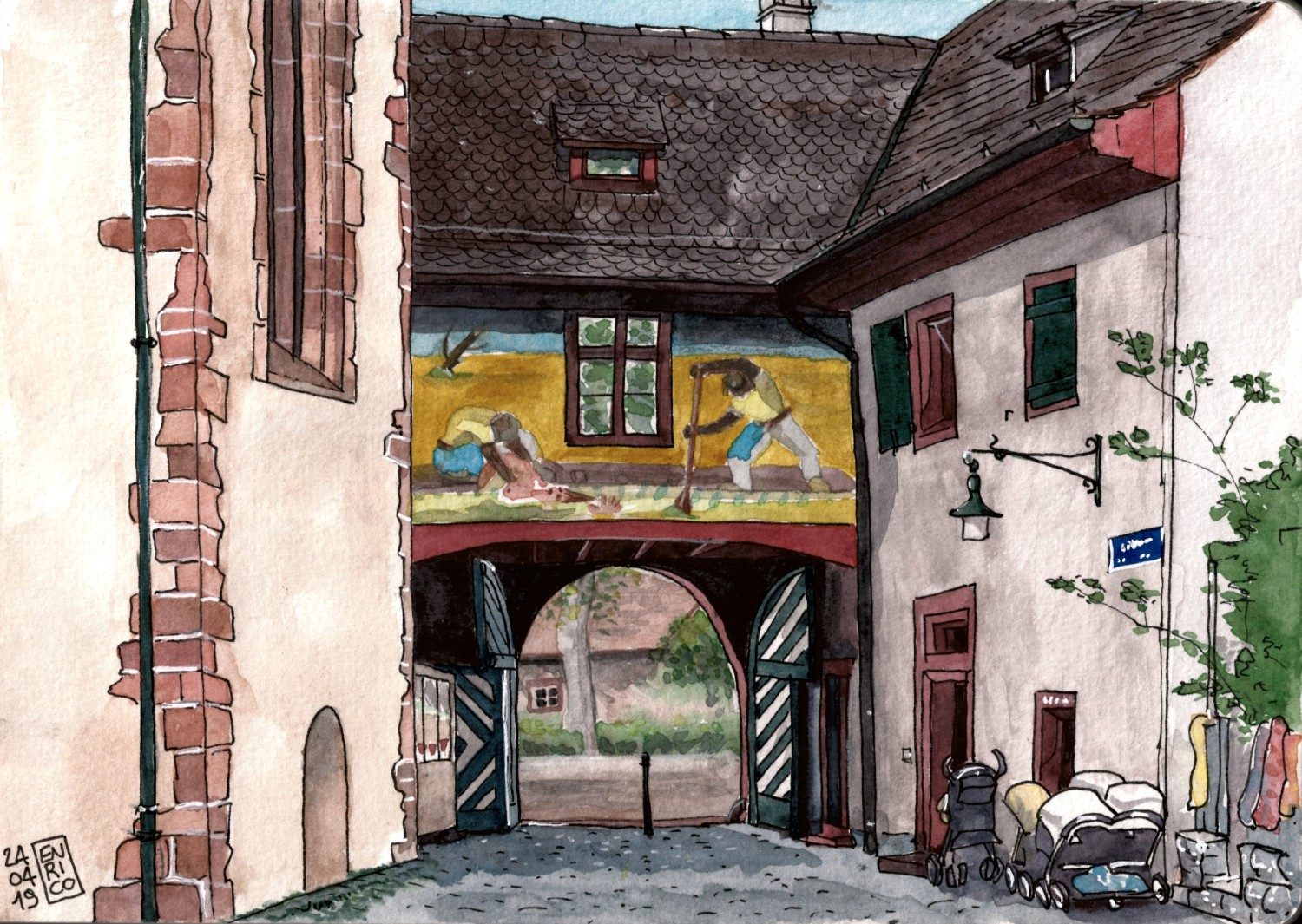 The archway over the entrance of the Lohnhof complex. It shows a beautiful mural painting of Niklaus Stoecklin, depicting what it seems a rescue of a drowning woman from the raging Rhine waters.