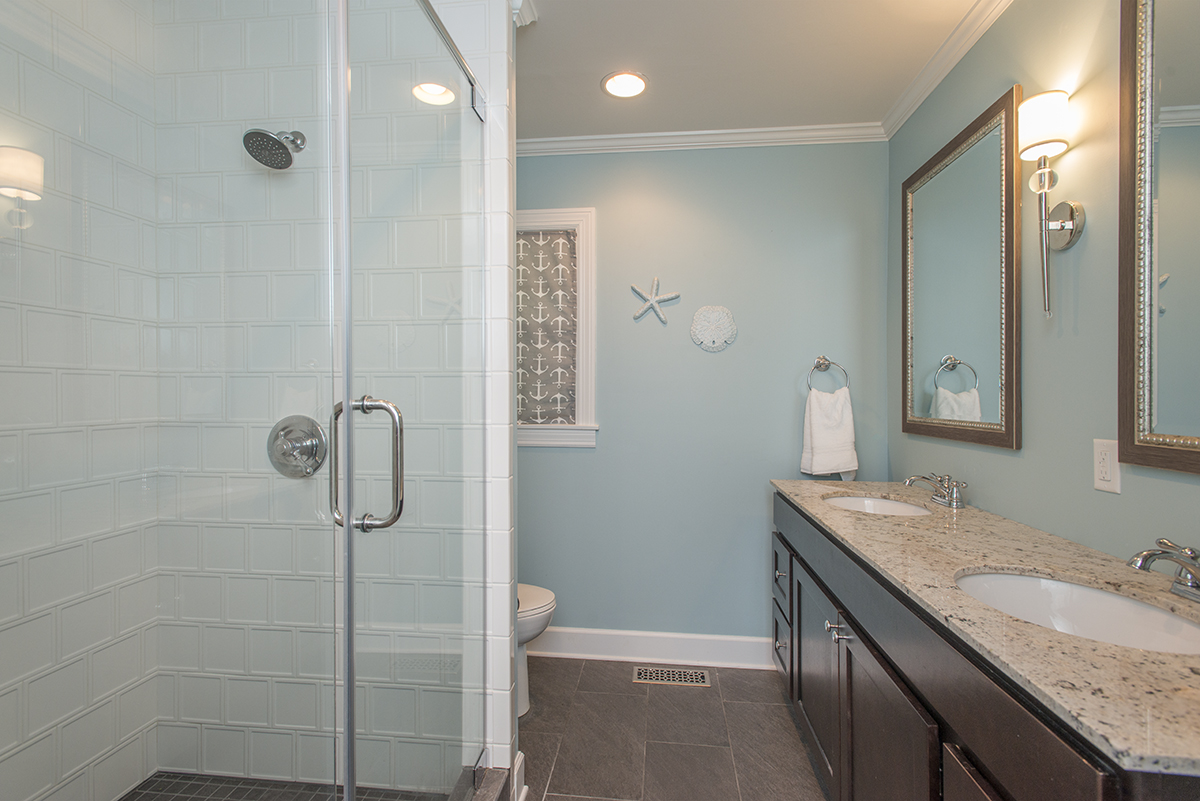 This is all new! It was a bathroom before but in a different layout and with way less space. Anna's design allowed us to have an amazing walk in shower, double vanity, and linen closet. My favorite story about this bath is how the contractor thought my tile pattern idea would be ugly… but when it was done he said it was one of his favorite showers they've ever done. Chris and I picked out the vanity and I painted the walls, made the roman shade, and picked the tile (same as laundry room), light fixture (probably my favorite light ever), and mirrors ($30 each, hey hey Kirklands).