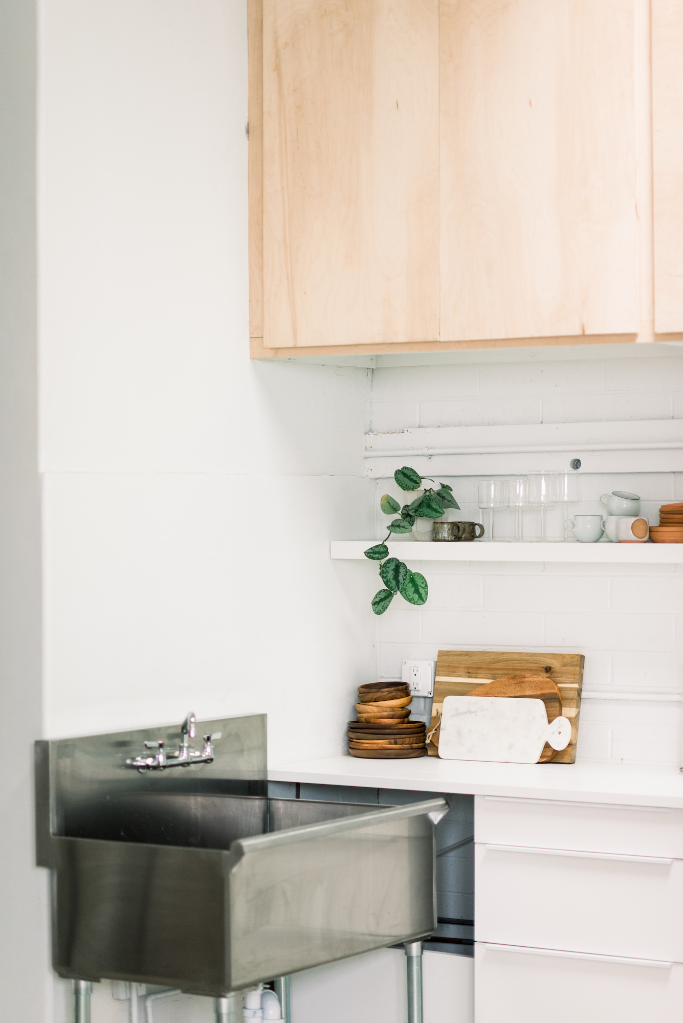Prep and Clean - counter space, cupboards, and an industrial sink to prep and clean