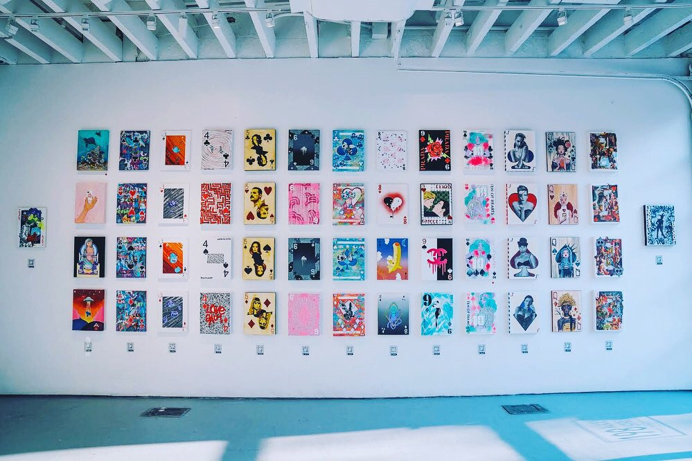 """- 54 cards by 15 artists create """"Playing to Win"""" (photo by @sebask)"""