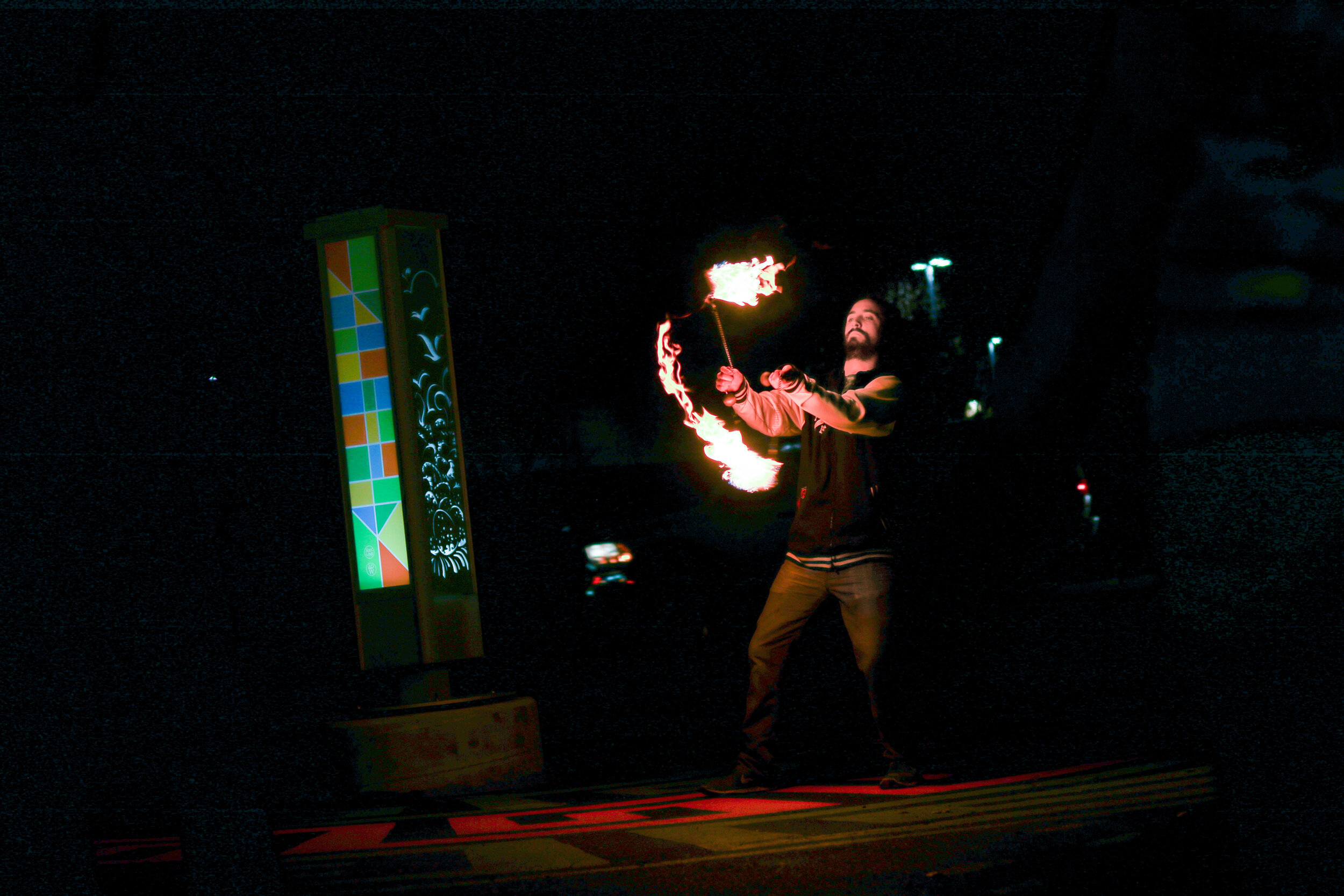 Fire Spinners light up the night sky at the 2018 Art Crawl. | Photo by 40 West Arts District