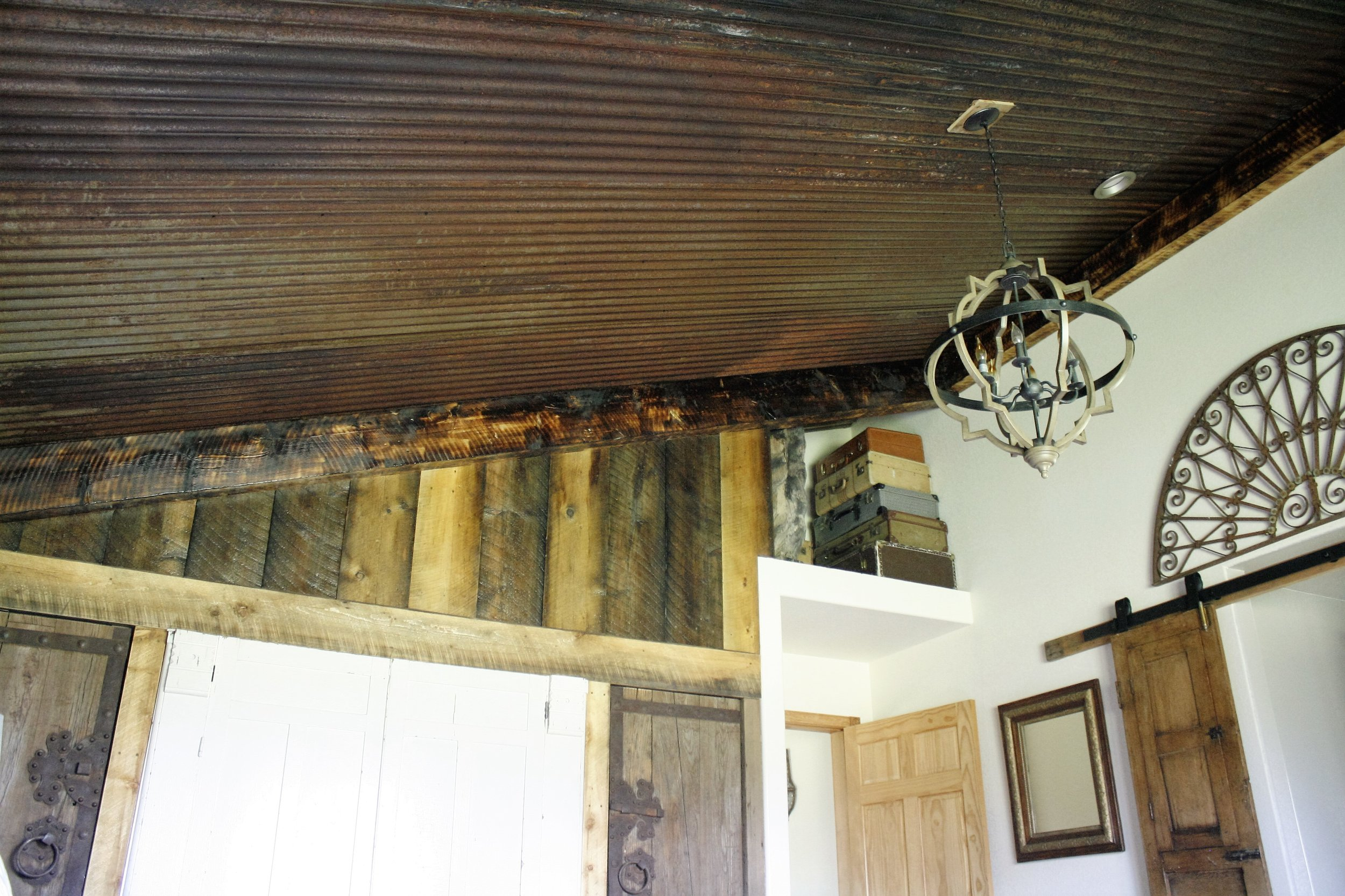 Rusted ceiling and reclaimed wood walls