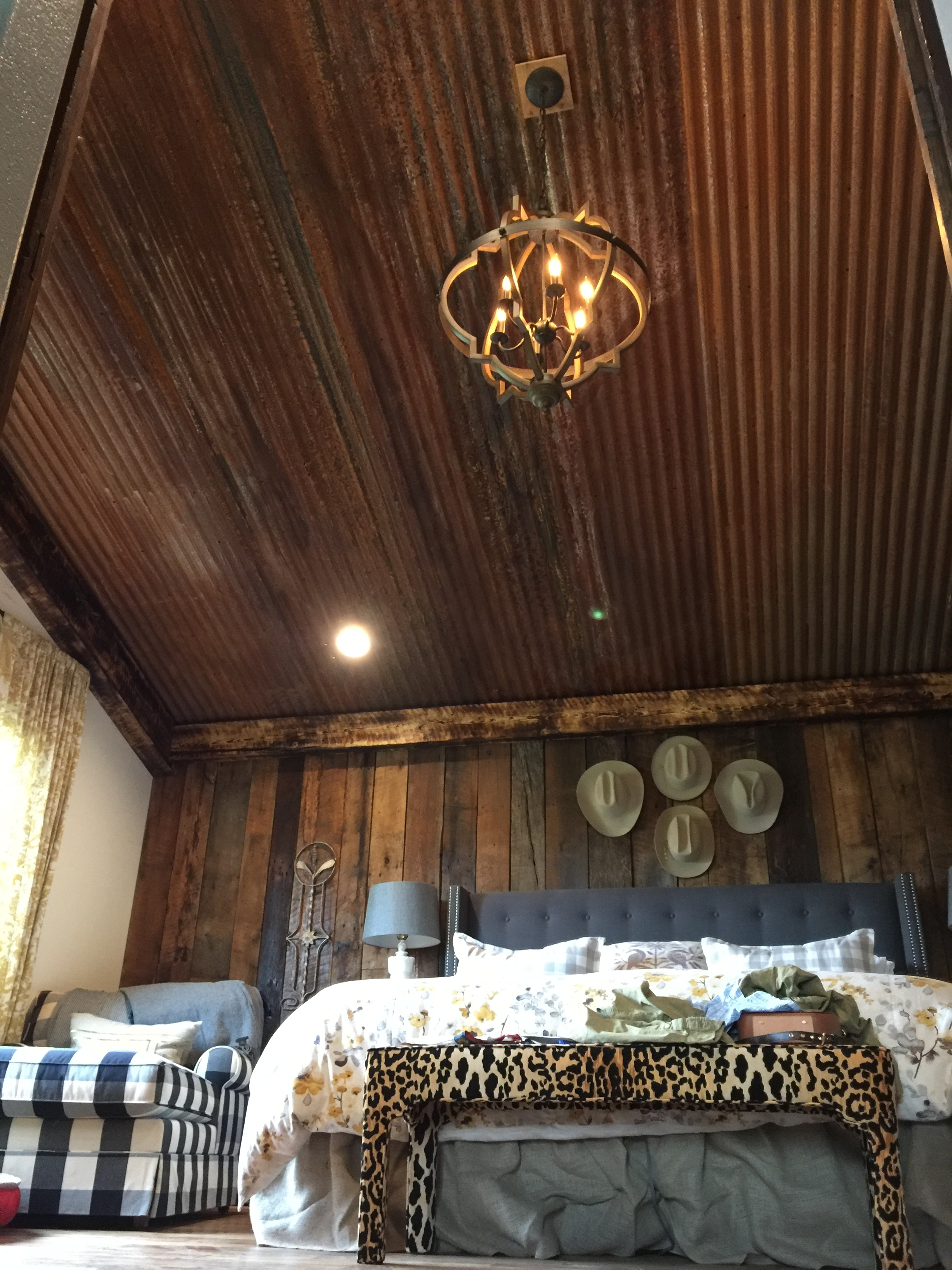 Rusted ceiling, barn wood wall, light fixture, hand burned rough cut beams install