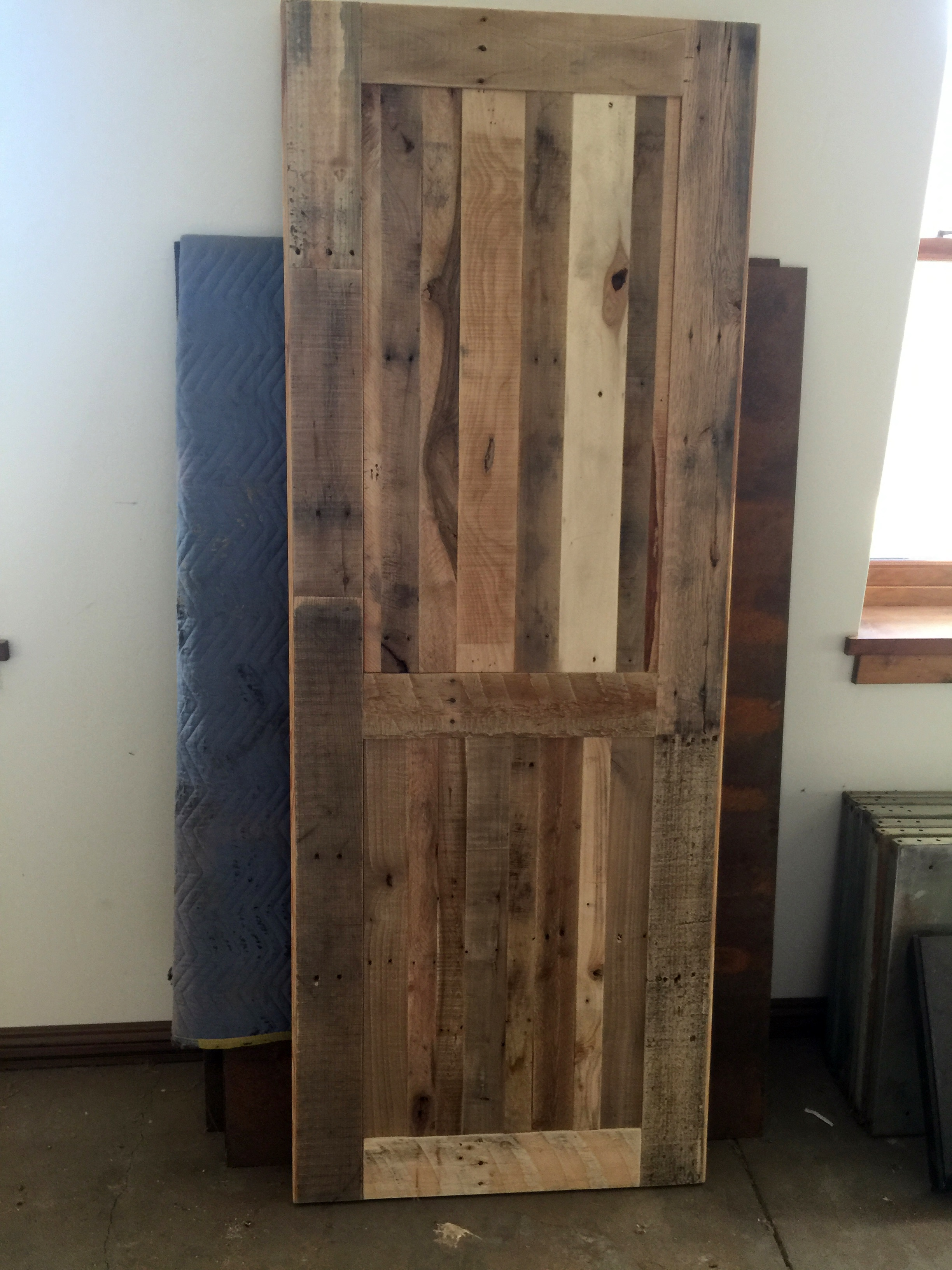 Custom, reclaimed pallet wood door