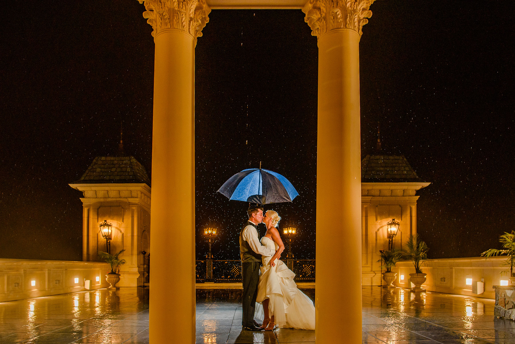 The Legacy Castle Wedding bride and groom in rain
