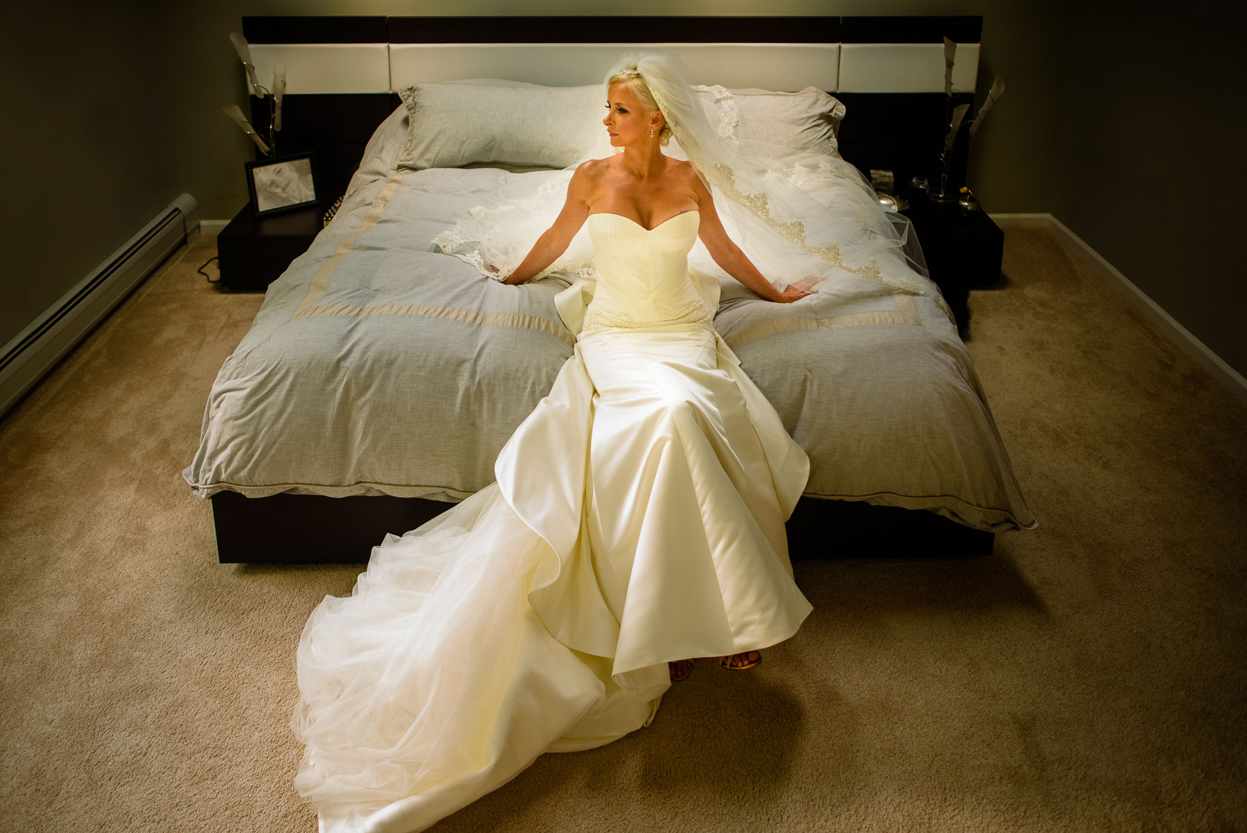 The Legacy Castle Wedding bride on a bed