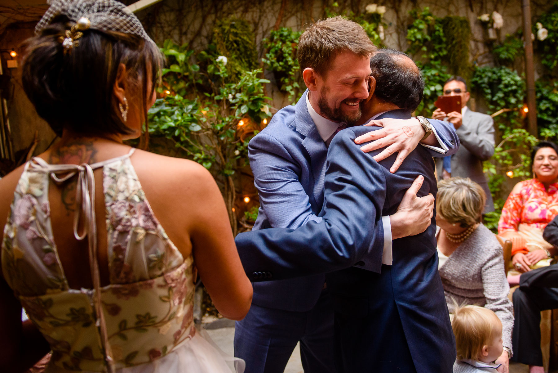 Palma Restaurant Wedding groom hugs father-in-law