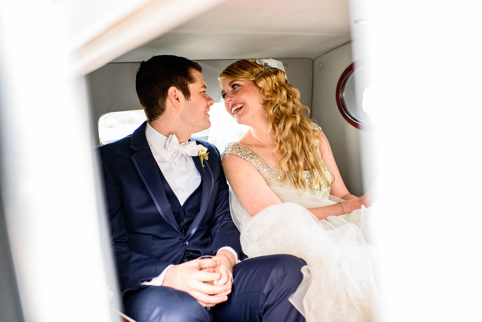 NYIT de Seversky Mansion Wedding bride and groom in a limo