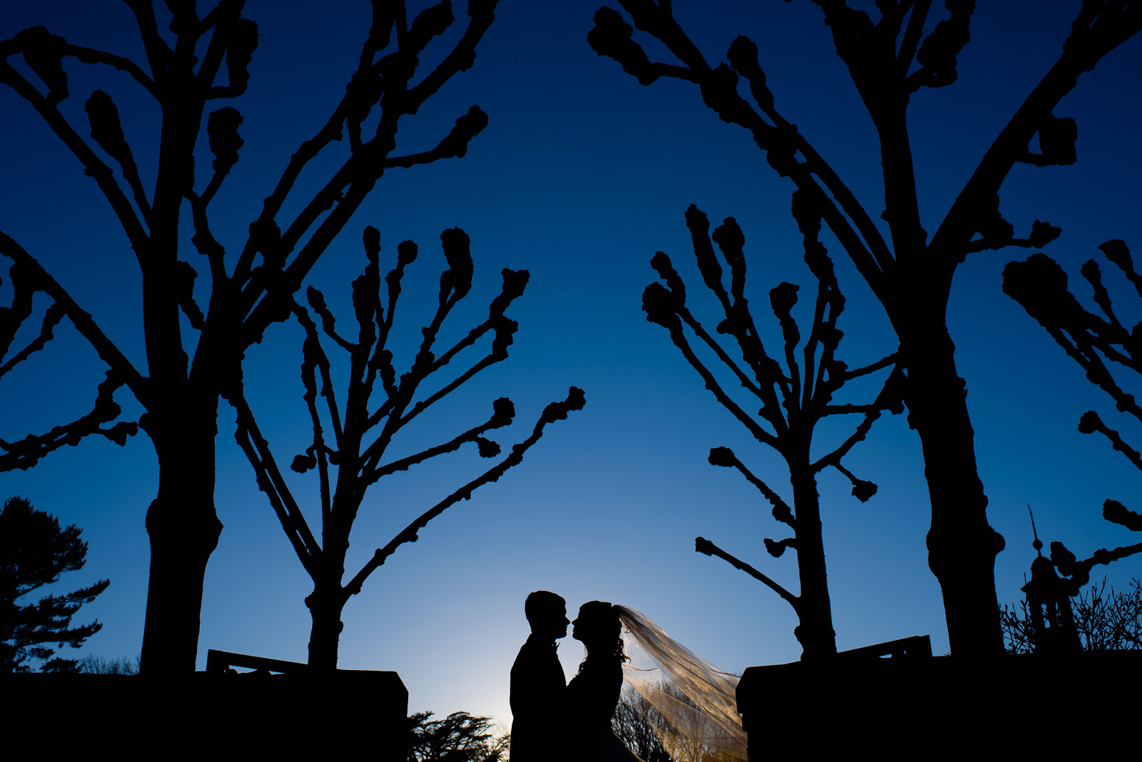 NYIT de Seversky Mansion Wedding bride and groom blue skies and