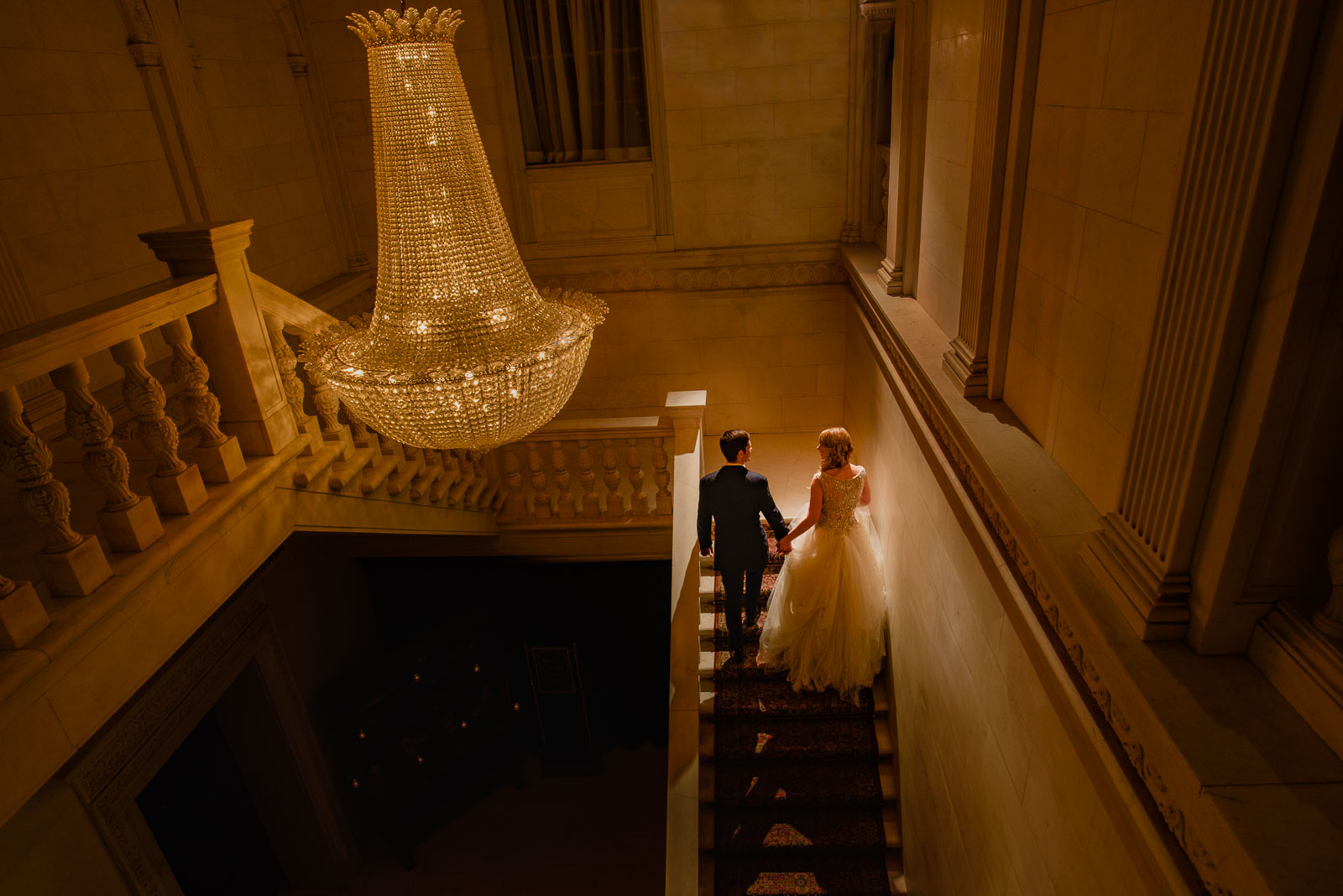 NYIT de Seversky Mansion Wedding bride and groom walking  on sta