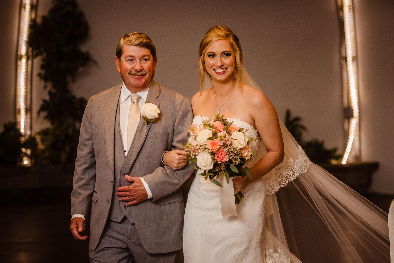 Wedding ceremony bride and dad