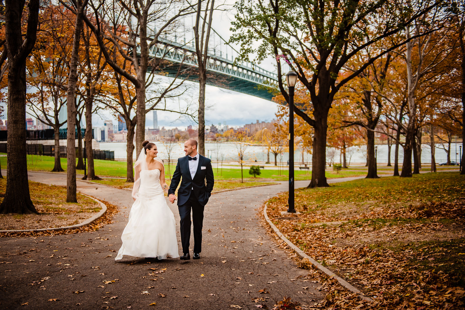 Bride's and groom walking in Astoria Park in Queens