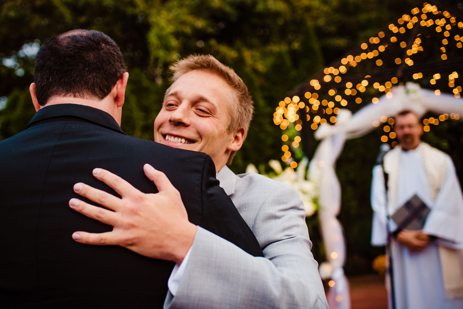 Groom hugs father in law