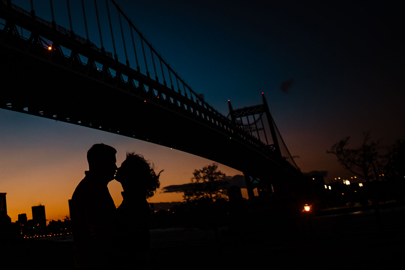 Couple's portrait with bridge