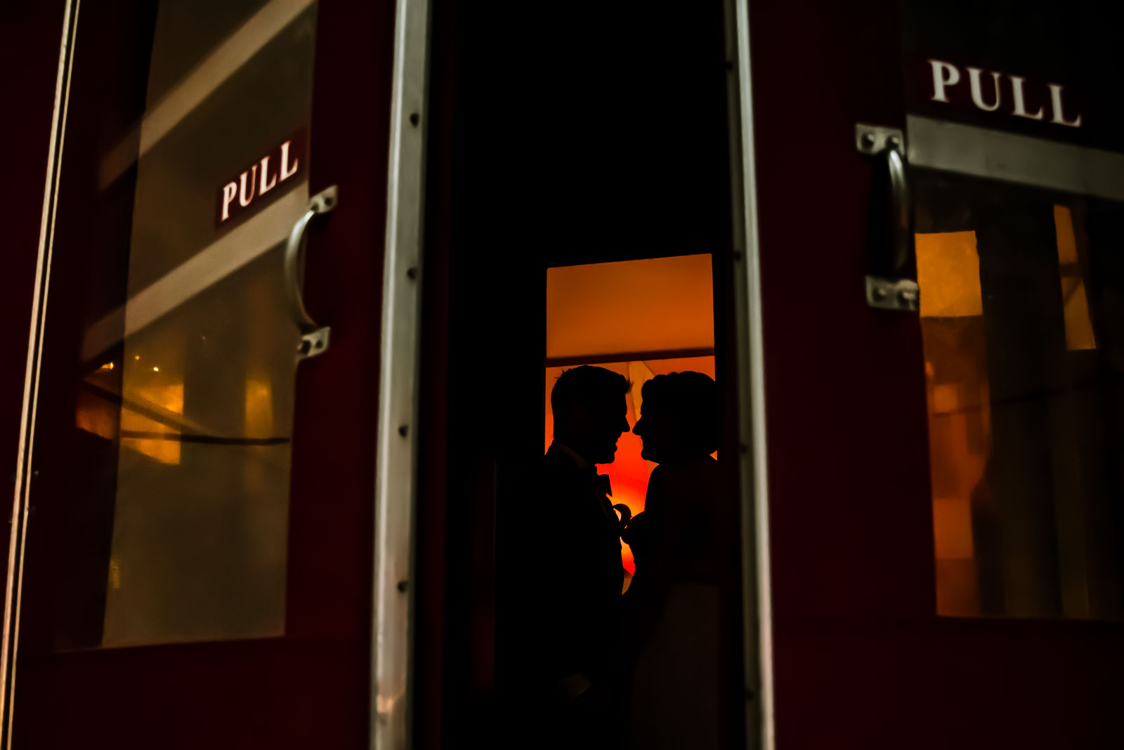 Bride and groom portrait in the doorway