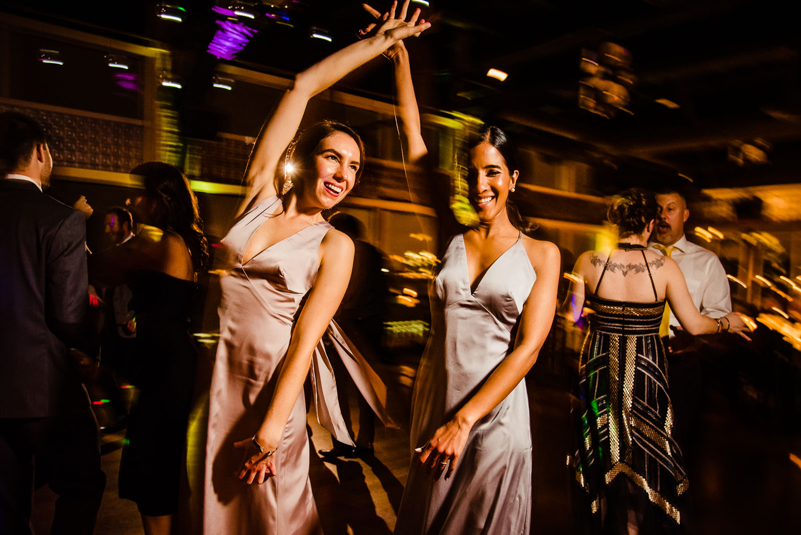 Two bridesmaids dance