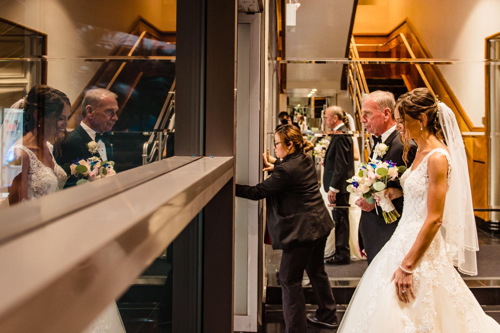 Wedding ceremony bride and her dad enter