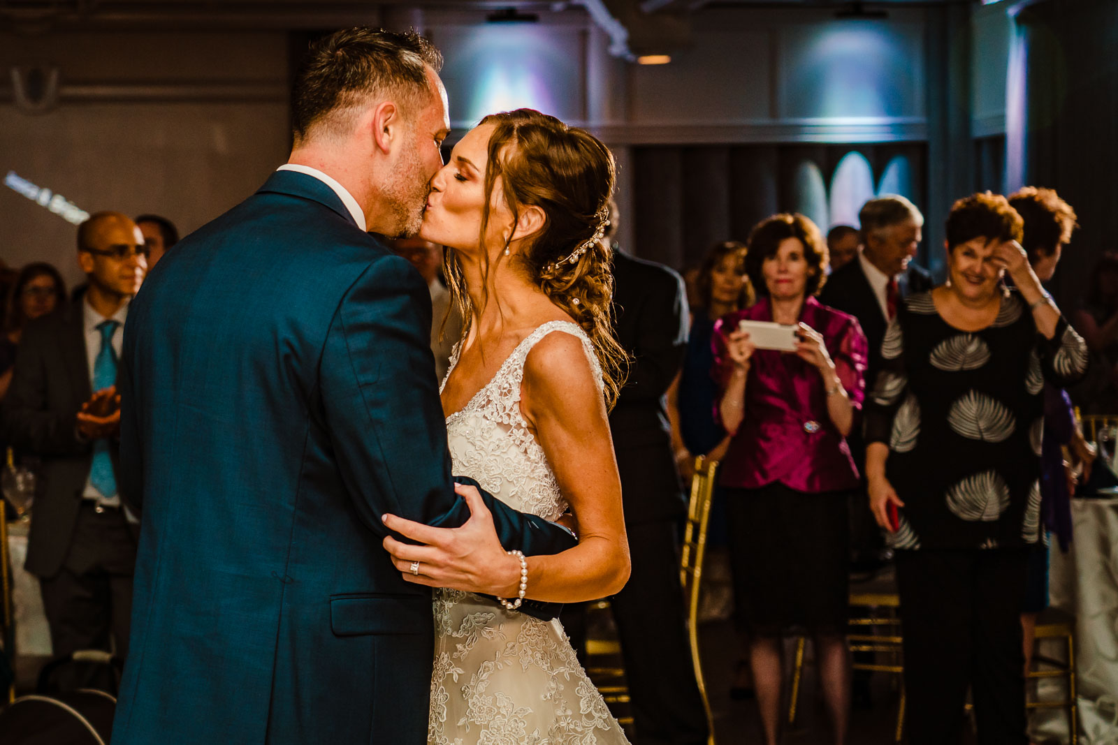 Bride and groom kiss during dance