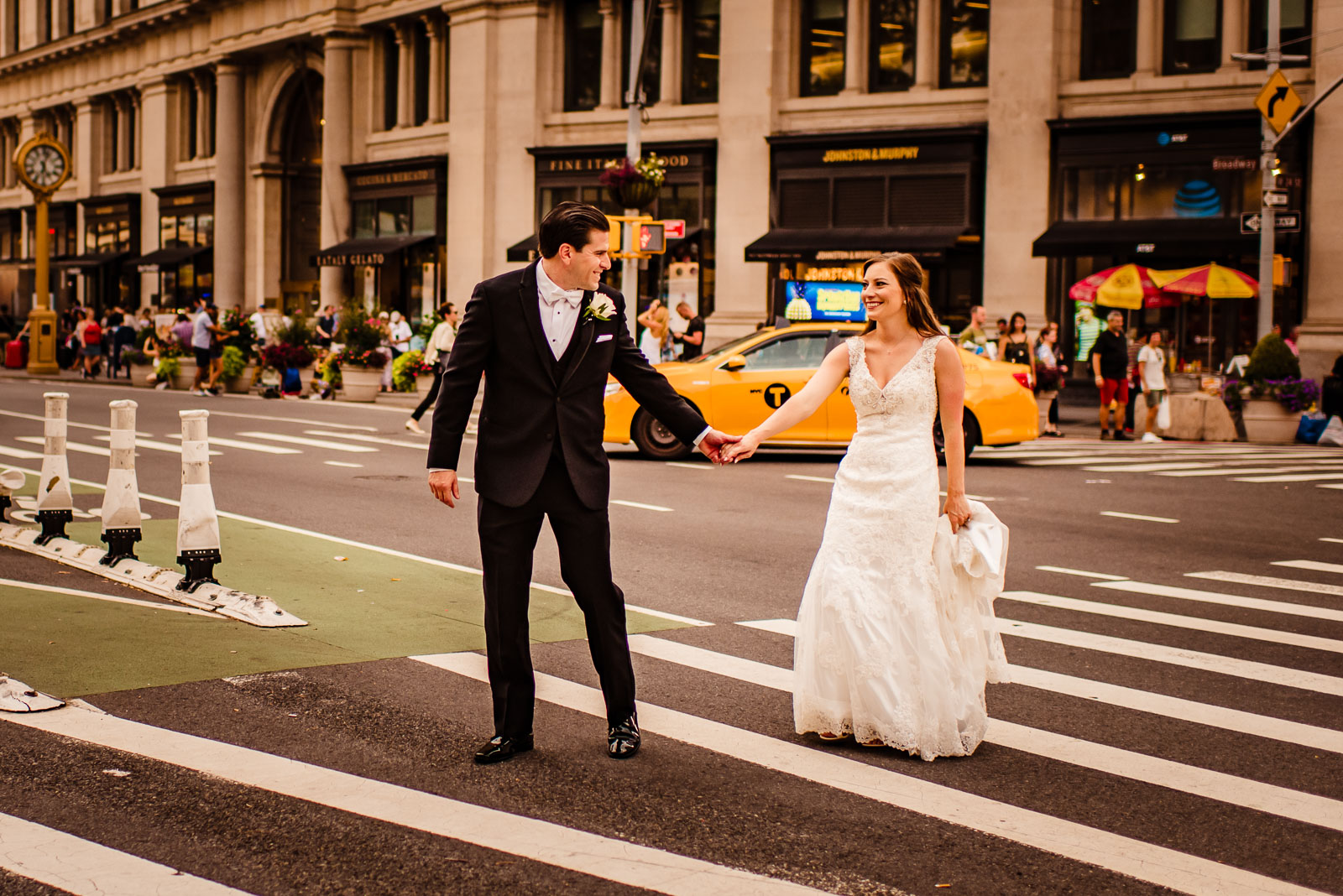 Bride and groom walk on NYC streets