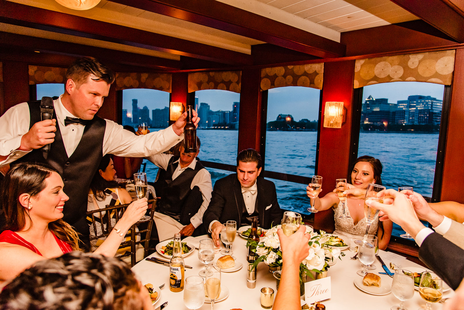 Groomsman toasts the couple
