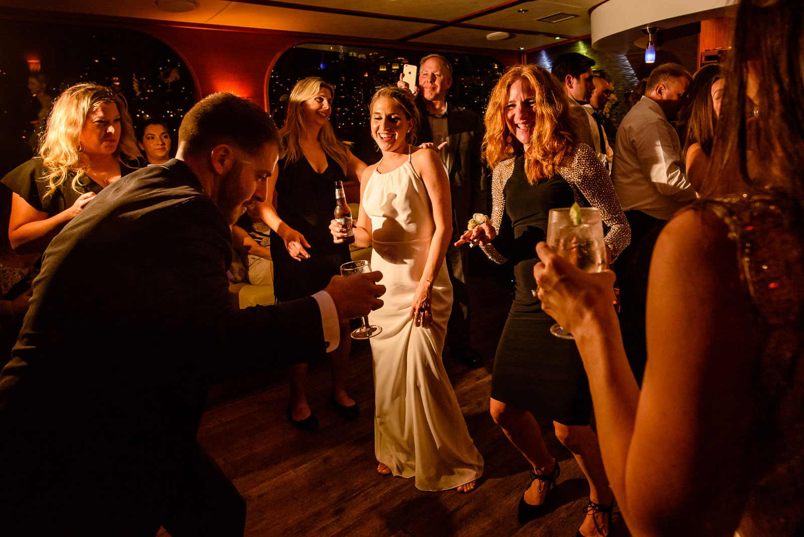 Guests dance during reception
