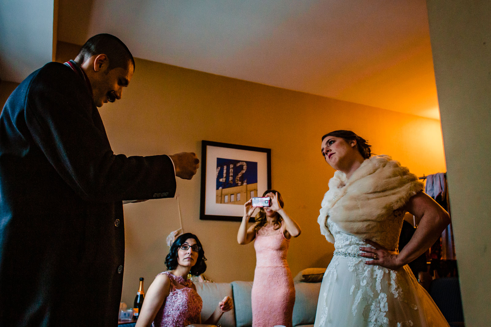 Bride and groom get ready in hotel
