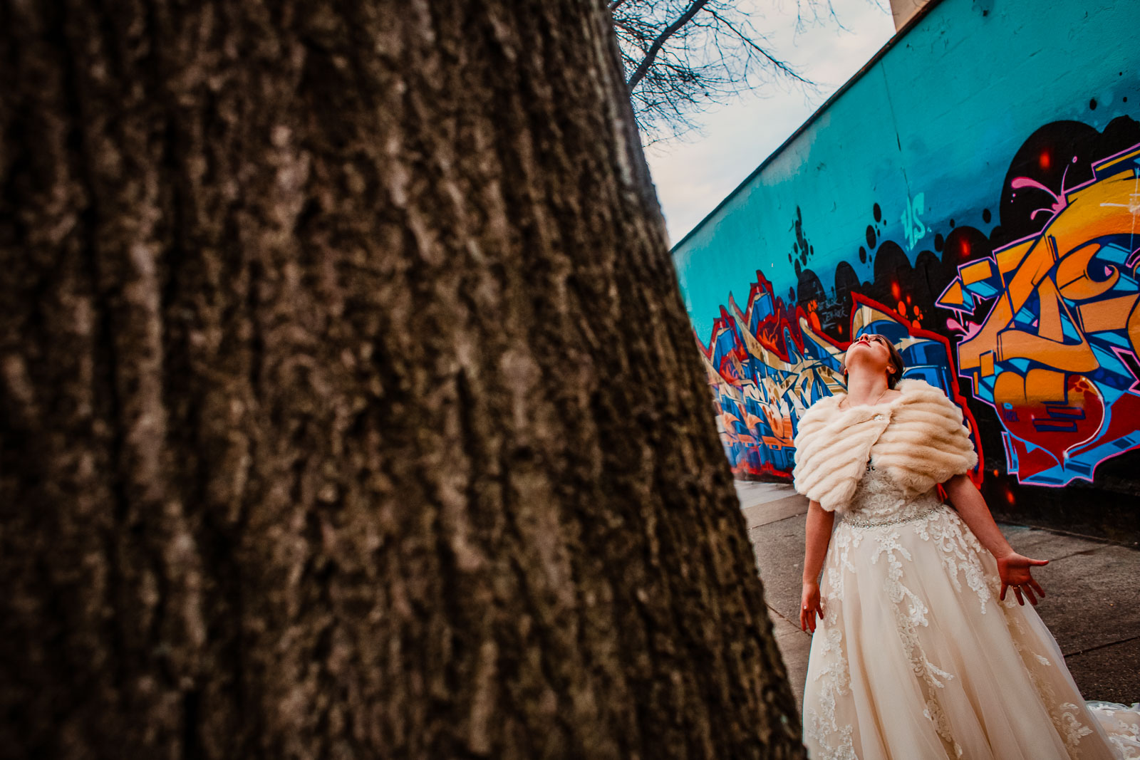 Bride looks up at sky