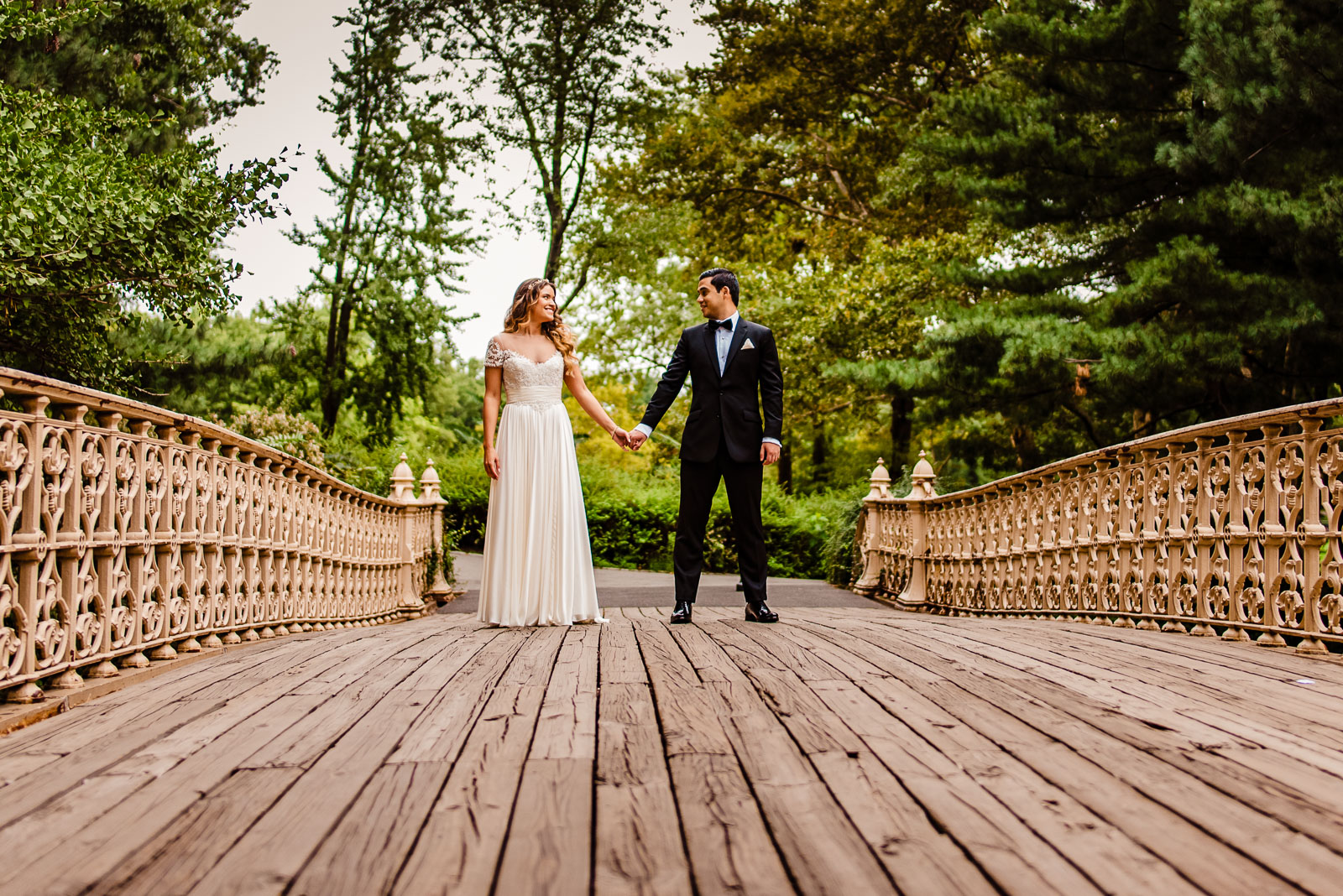 Brdie and groom portrait on bridge