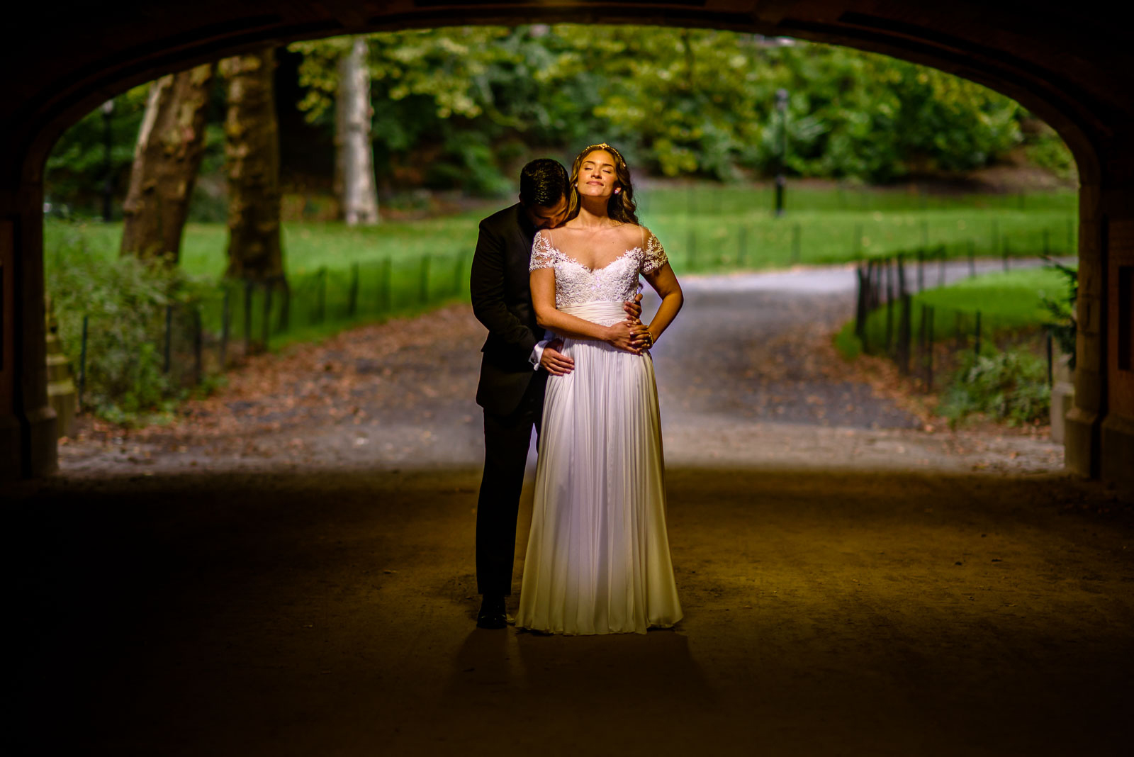 Brdie and groom portrait in tunnel