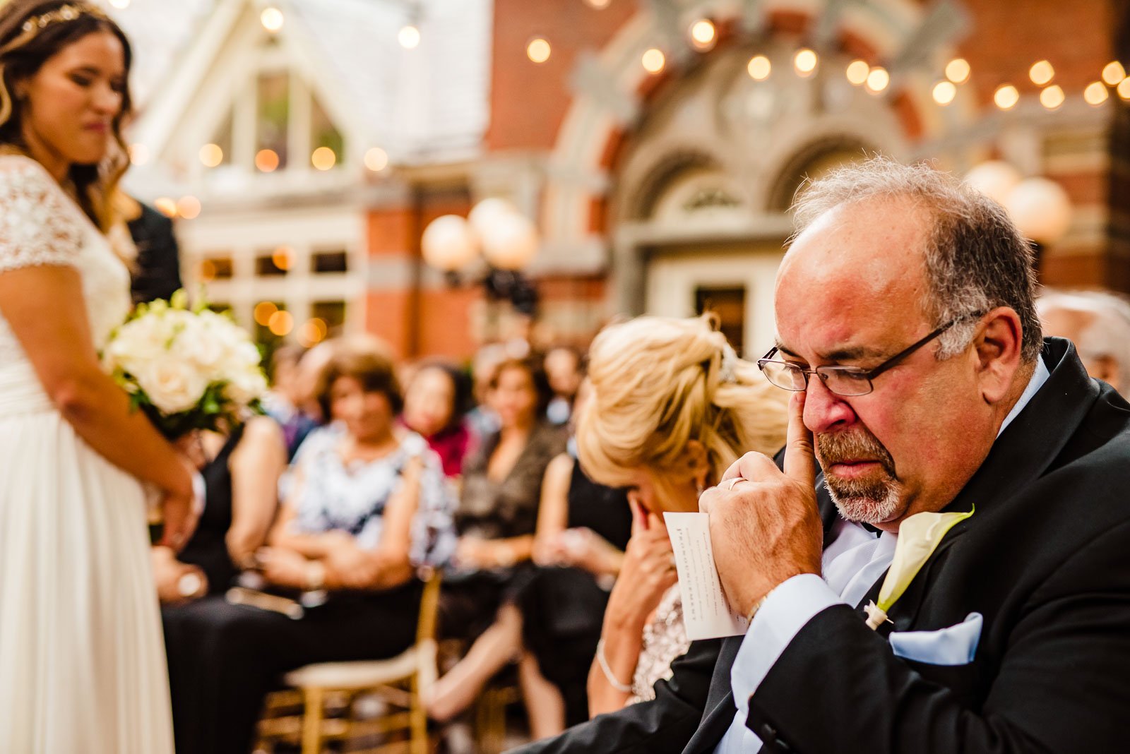 Father of the bride cries during ceremony