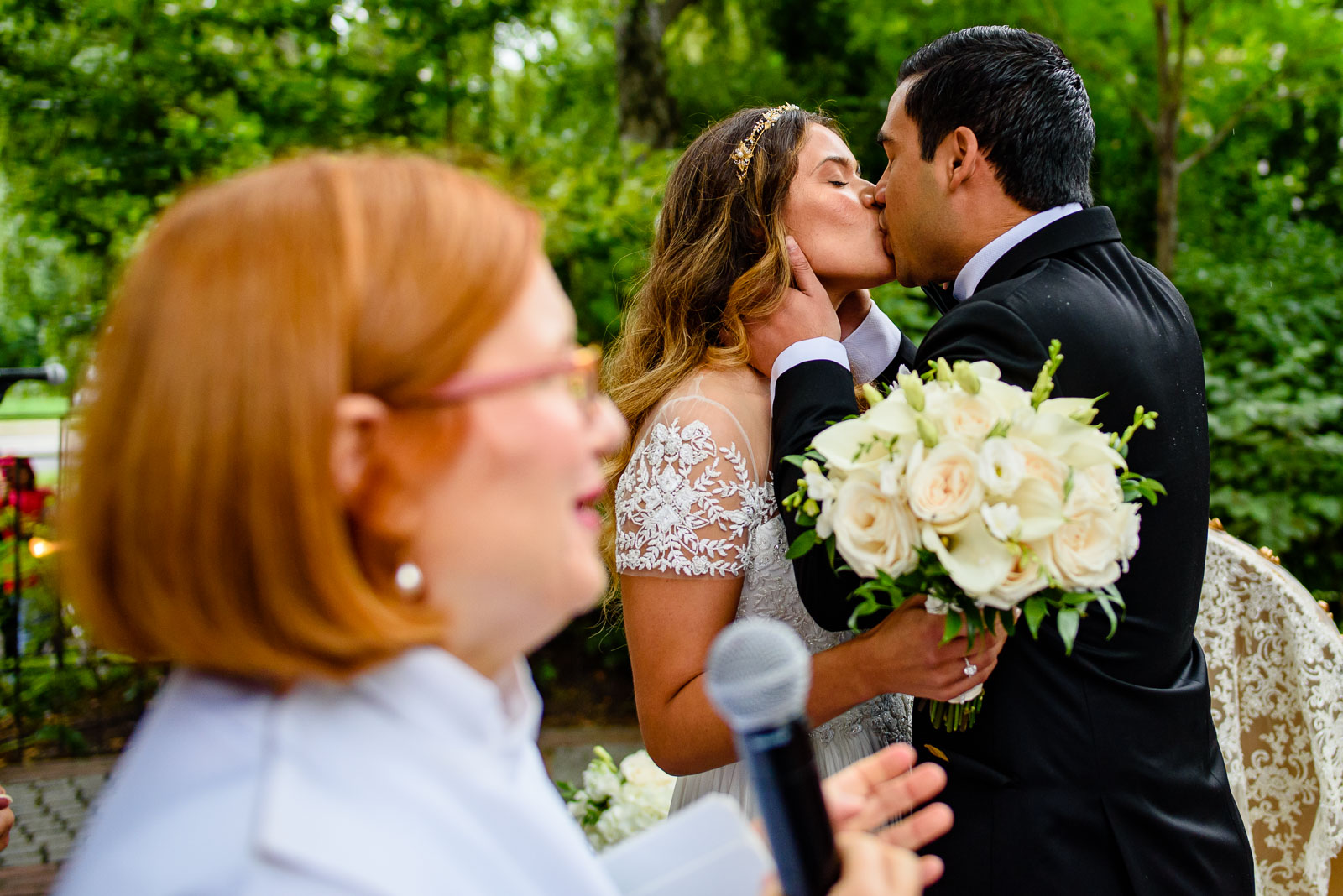 Bride and groom first kiss during ceremony
