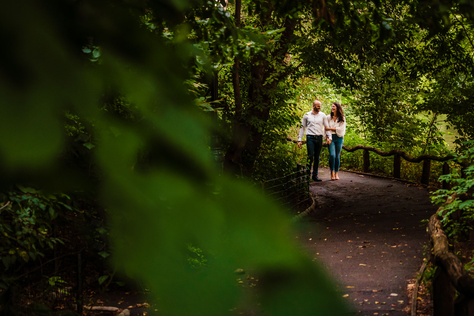 Couple strolls in alley in Central Park