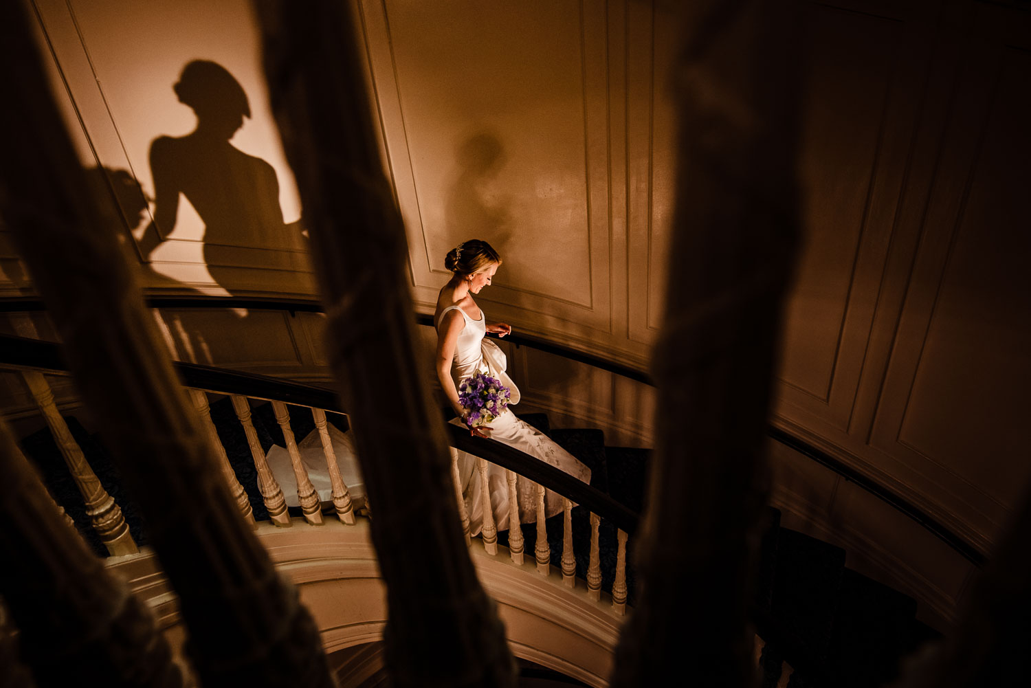 Bride walks down the spiral staircase