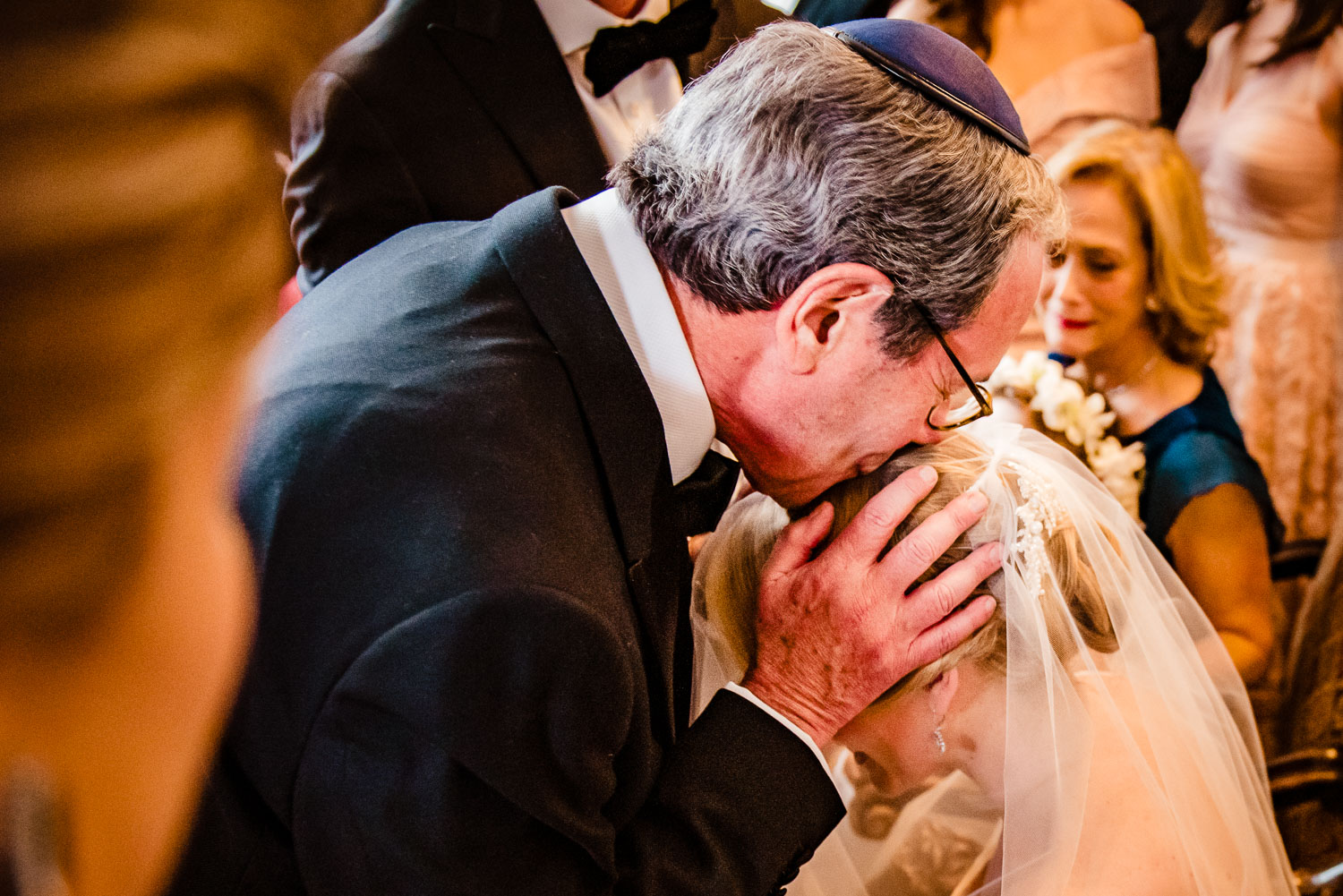 Father gives blessing to the bride