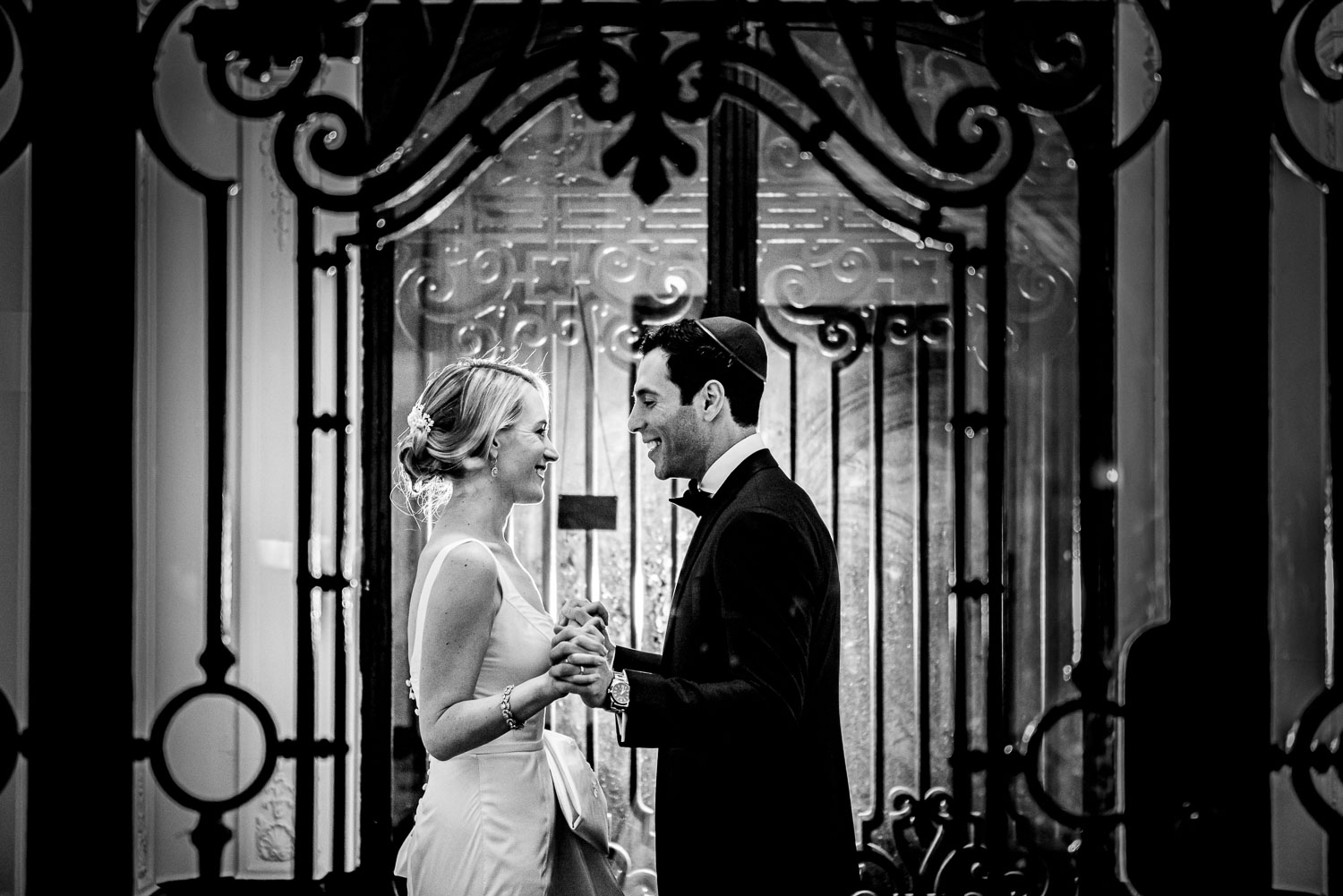 Bride and groom portrait inside the front doors