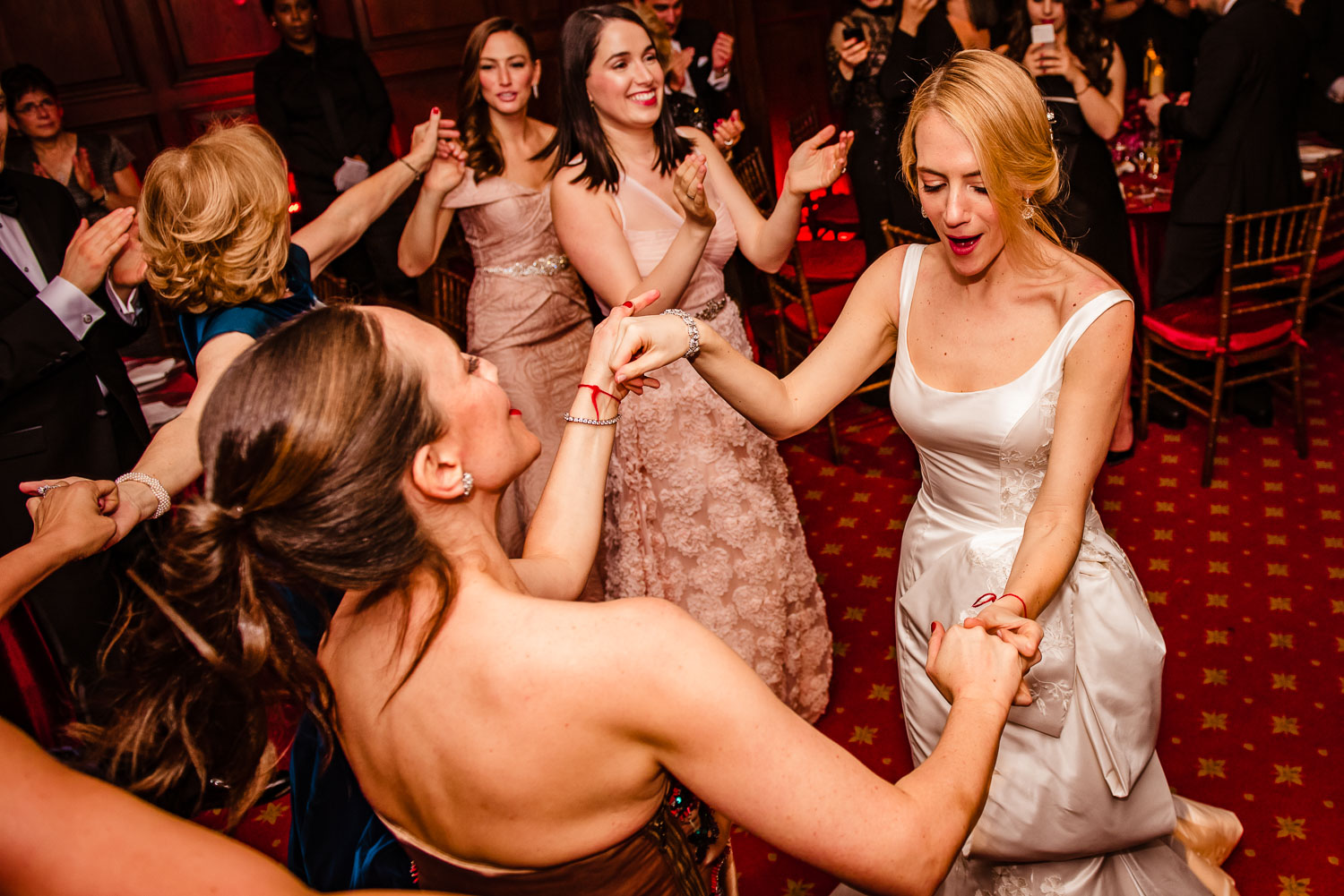 Bride dances with her maid of honor