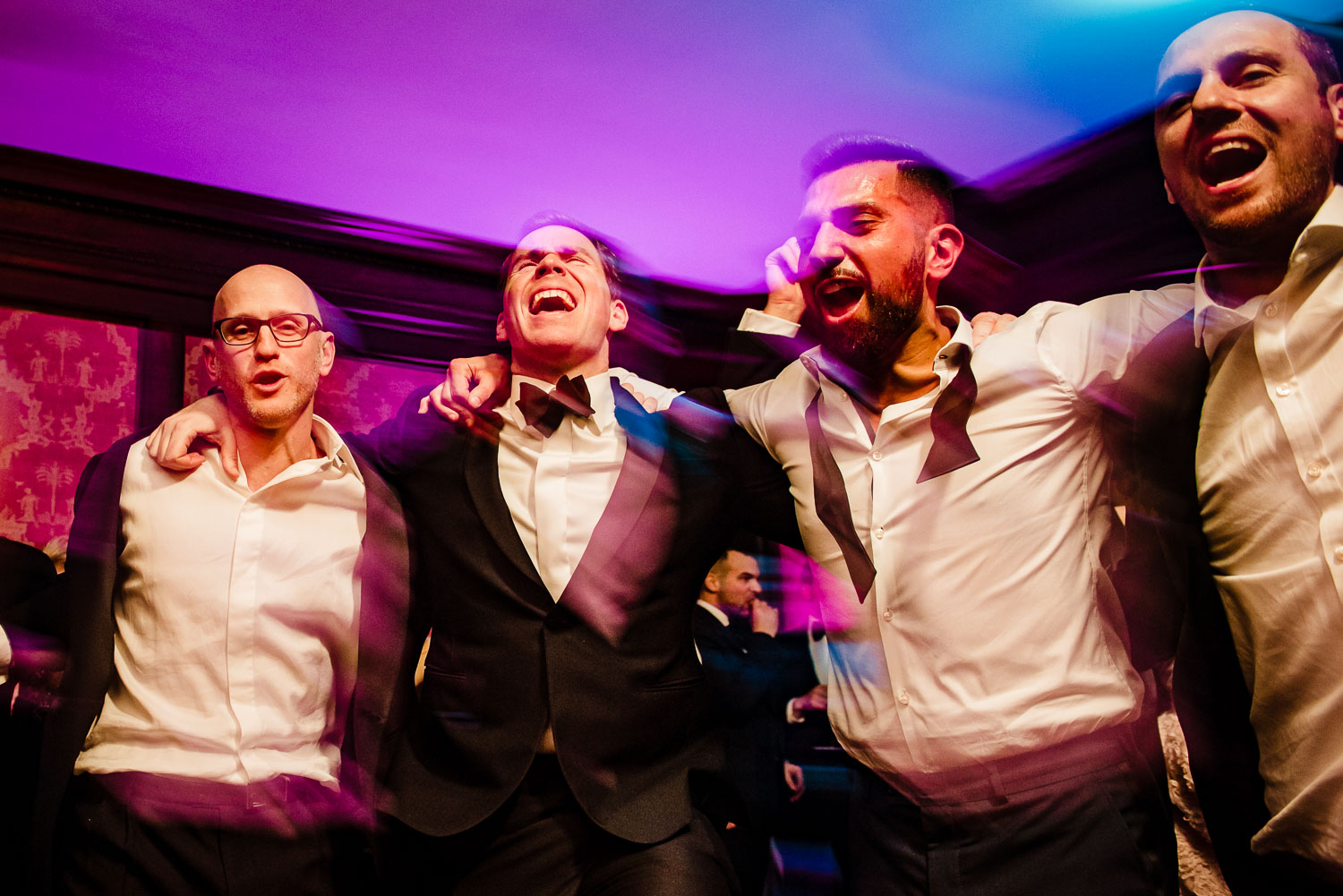 Groomsmen dance during reception