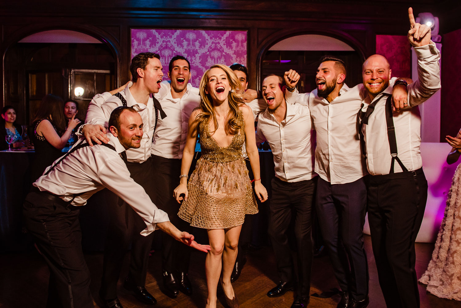 Bride and groomsmen on the dance floor