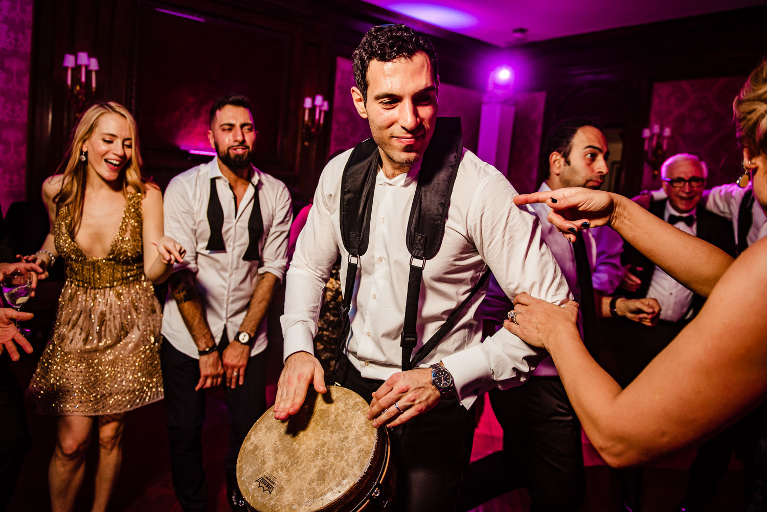 Groom plays drums during recption