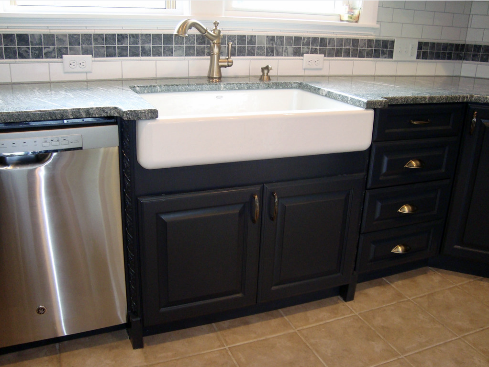 apron sink, in either cast iron or fireclay, installed in a kitchen.