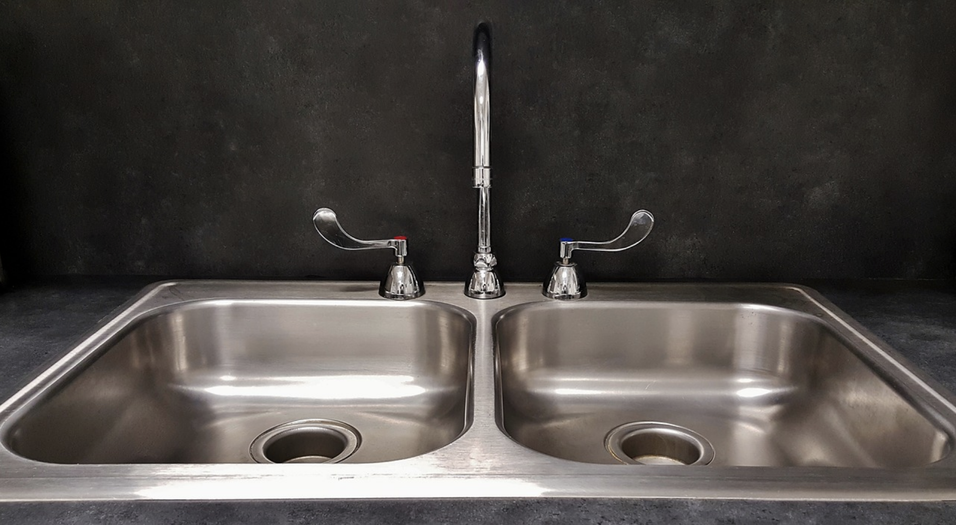 Strainless steel double bowl sink. Depicting a bit shallower bowls.