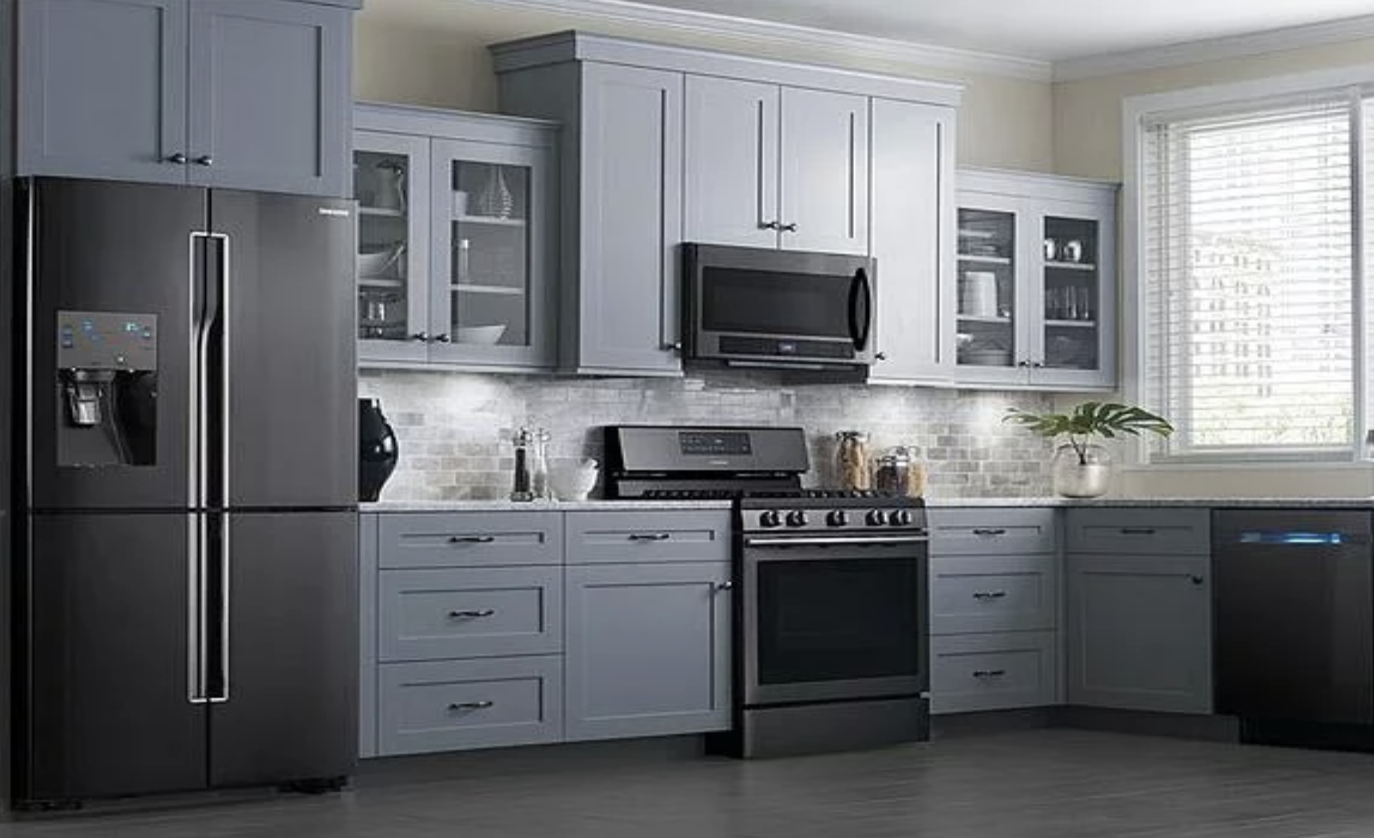 kitchenaid's black stainless steel suite  pairs perfectly with neutral blue cabinets.