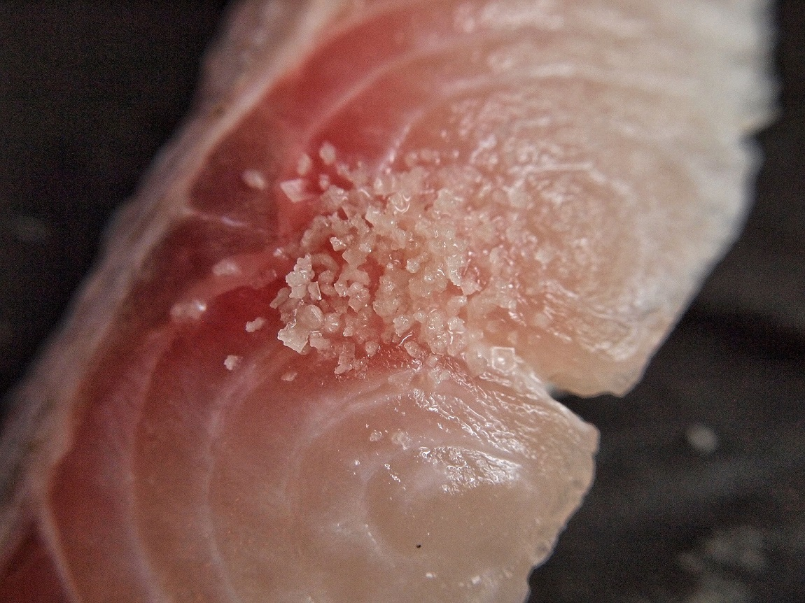 Amabito No Moshio seaweed salt from Japan on top of sea bass sushi.